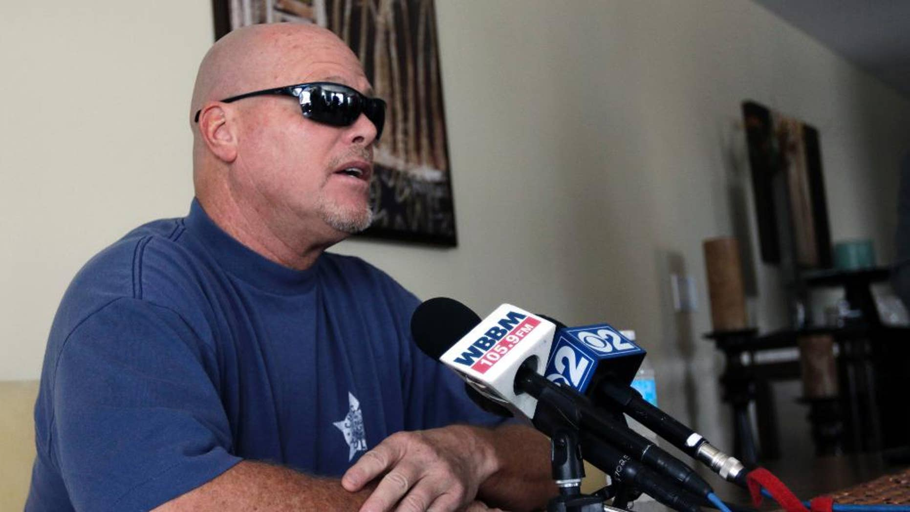 Former NFL football quarterback Jim McMahon speaks during a news conference Tuesday, June 17, 2014 in Chicago.  McMahon spoke of his ongoing battle with dementia that he believe is related to his years of hits he took while playing in the league. McMahon is part of a federal lawsuit filed in San Francisco accusing teams of illegally dispensing powerful narcotics and other drugs to keep players on the field without regard for their long-term health. He led the Chicago Bears to victory in the 1985 Super Bowl. (AP Photo/Stacy Thacker)