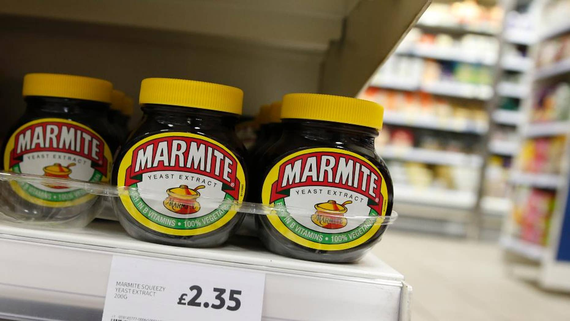 FILE - This is a Thursday, Oct. 13,2016 file photo of jars of savoury spread 'Marmite' which is owned by the Anglo-Dutch multinational Unilever, on sale in a supermarket  in central London. Consumer products giant Unilever said Thursday April 6, 2017 that it plans to sell its spreads division and combine its foods and refreshments units as part of a major review of operations prompted by a $143 billion takeover bid by rival Kraft Heinz that fell through in February.  (AP Photo/Alastair Grant)