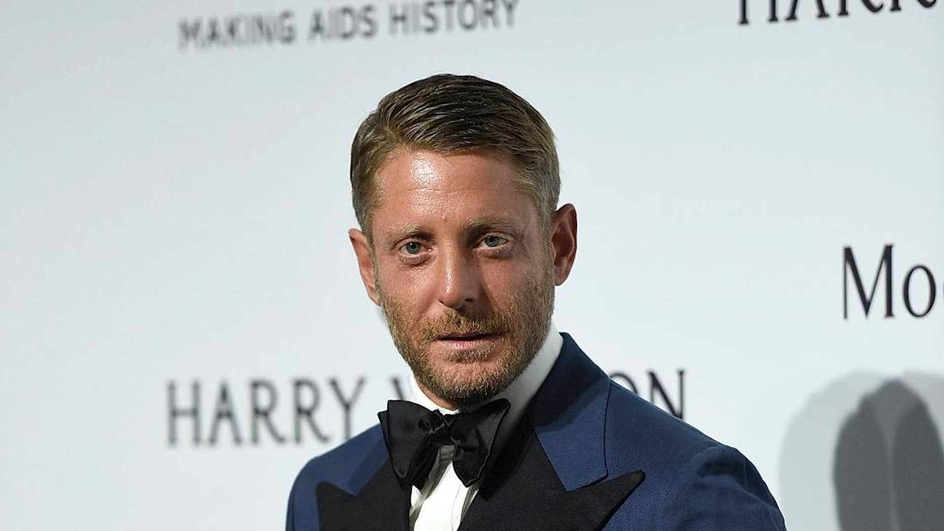 FILE - In this Sept. 26, 2015 file photo, Lapo Elkann arrives for an amfAR charity dinner in Milan, Italy. A criminal charge by the Manhattan district attorney has been dropped against the playboy grandson of the Italian founder of Fiat Automobiles who had been accused of filing a false report when he claimed he was being held against his will in New York City. The 39-year-old was arrested outside a public housing project in December 2016 after his family contacted police, saying he needed $10,000 to guarantee his safety. But authorities say he made up the story after he ran out of money following a two-day binge with an escort. (AP Photo/Giuseppe Aresu, File)
