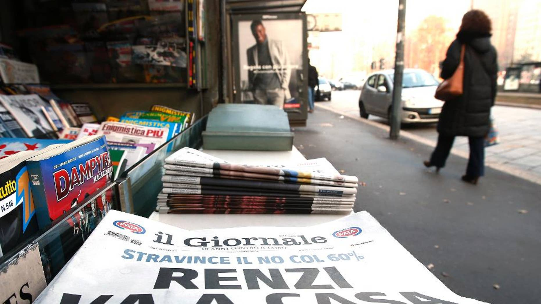"A newspaper headline reads in Italian ""Renzi goes home"" following the result of Sunday's constitutional referendum, at a newsstand in Milan, Italy, Monday, Dec. 5, 2016. Italian voters dealt Premier Renzi a resounding rebuke early Monday by rejecting his proposed constitutional reforms, plunging Europe's fourth-largest economy into political and economic uncertainty. (AP Photo/Antonio Calanni)"