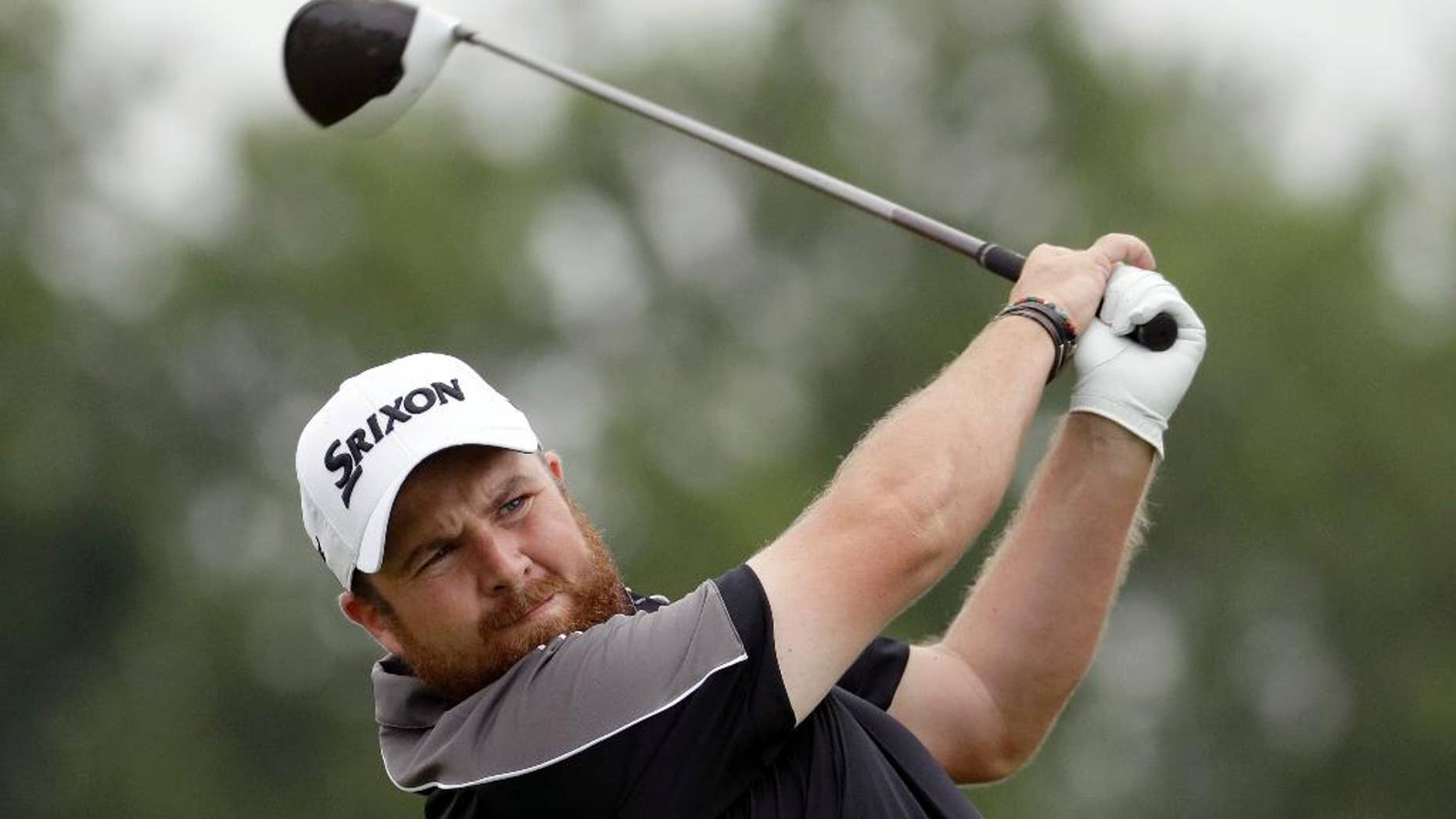 FILE - In this June 17, 2016, file photo, Shane Lowry, of Ireland, watches his tee shot on the 18th hole during the rain delayed first round of the U.S. Open golf championship at Oakmont Country Club in Oakmont, Pa. Lowry has pulled out of the Olympics because of concerns over the Zika virus. Lowry said Tuesday, June 28, 2016, he received medical advice that he should not travel to Rio de Janeiro. (AP Photo/Charlie Riedel, File)