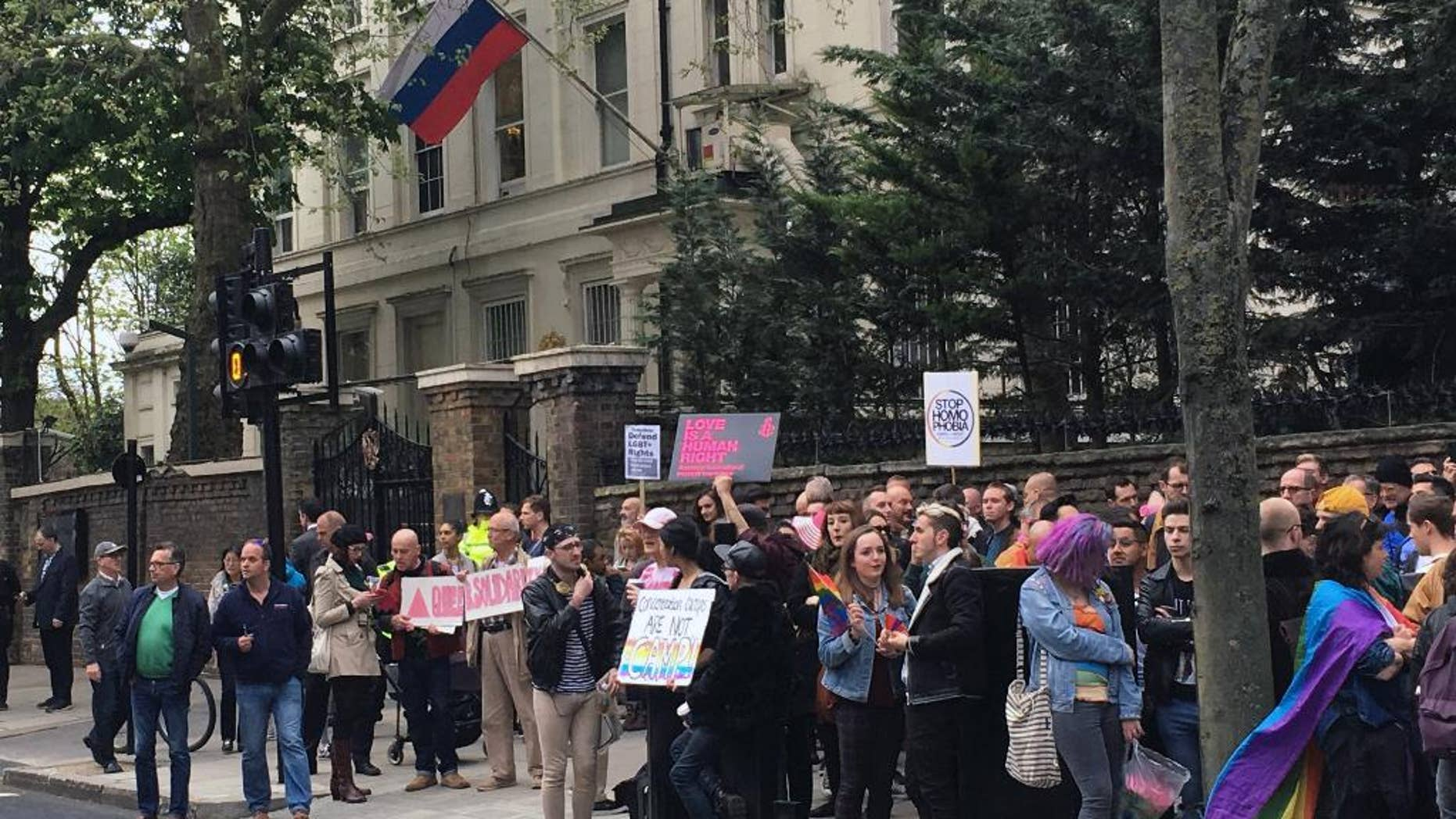 """People protest outside the Russian Embassy in London, following reports of the torture and murder of gay men in Chechnya, Wednesday April 12, 2017. The United Nations' High Commissioner for Human Rights called upon the Russian government in a statement """"to put an end to the persecution of people perceived to be gay or bisexual, while Chechen authorities denied the reports, and spokesman for leader Ramzan Kadyrov insisted there were no gay people in Chechnya. (Thomas Hornall/PA via AP)"""