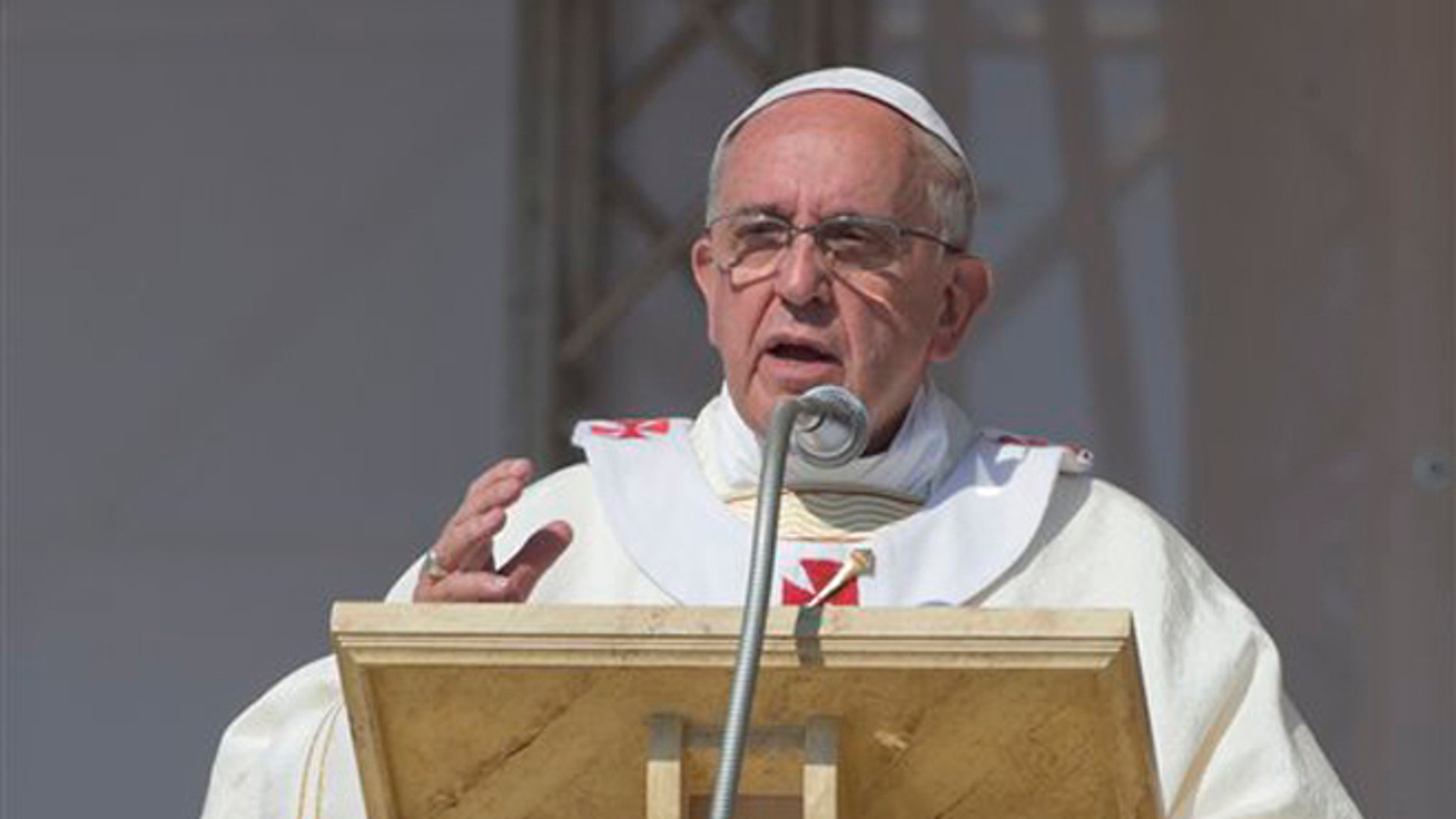 Pope Francis celebrates a Mass in Sibari, southern Italy, Saturday, June 21, 2014. Pope Francis paid a one day visit to Castrovillari, Sibari, and Cassano allo Jonio, in the Calabria region of Italy. Pope Francis comforted the imprisoned father of a slain toddler during a visit Saturday to a southern Italian region infested by one of the world's most powerful crime syndicates. During his one-day pilgrimage to Calabria, Francis met separately with the father and two grandmothers of Coco' Campolongo in the courtyard of a prison in the town of Castrovillari. (AP Photo/Alessandra Tarantino)