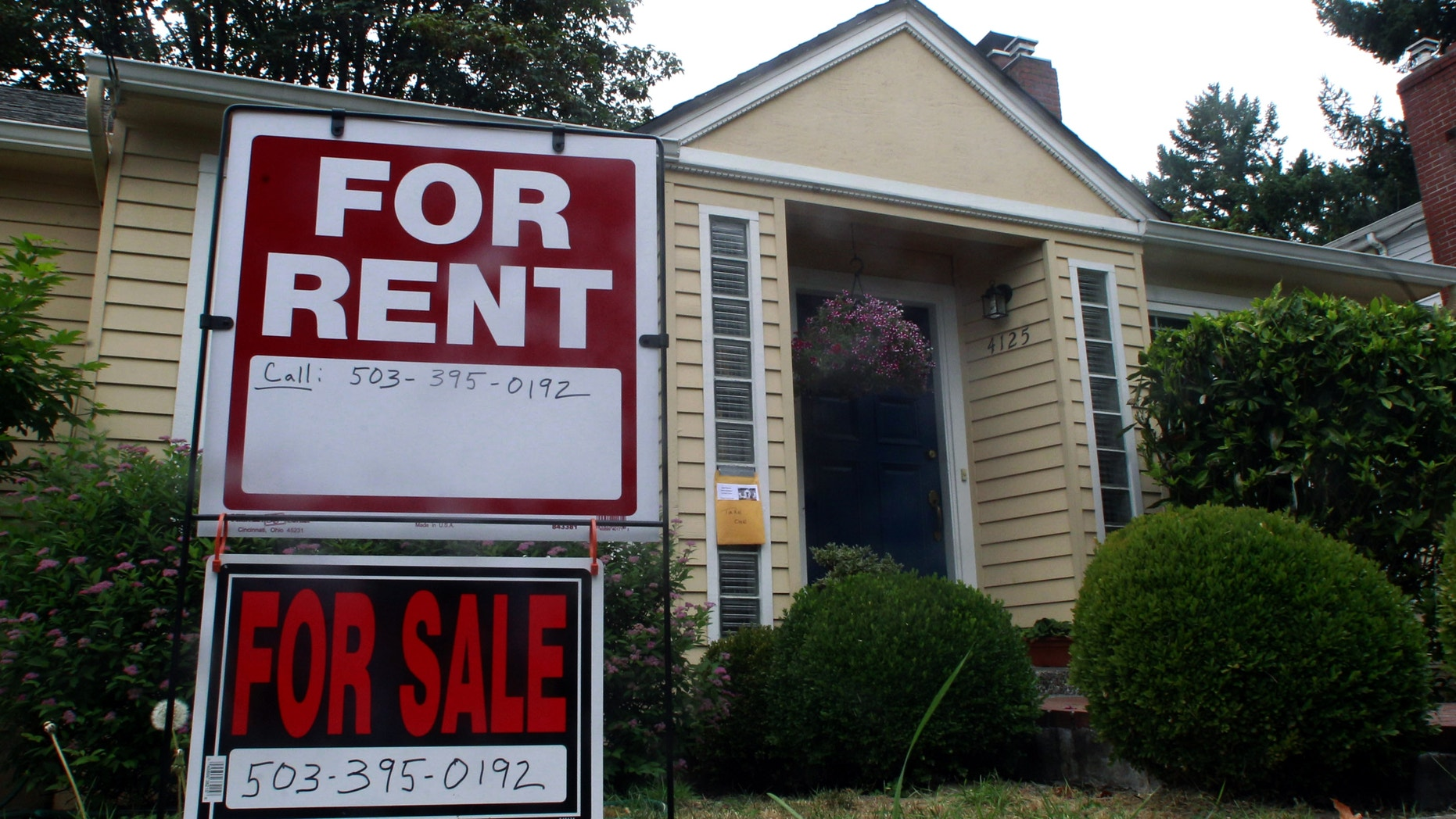 FILE - In this Sept. 13, 2011, file photo, a house is for rent an for sale in Portland, Ore. Experts say owning rental housing can pay off even as market recovers. (AP Photo/Rick Bowmer, File)