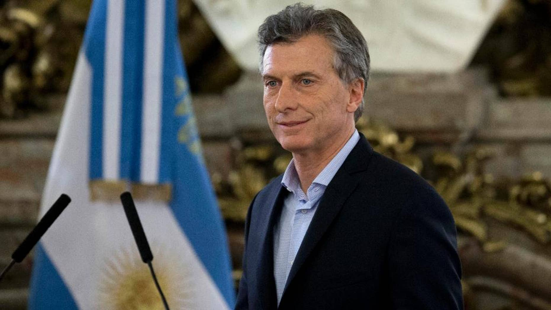 "FILE - In this April 7, 2016 file photo, Argentina's President Mauricio Macri arrives at government house in Buenos Aires, Argentina. The presidency said in a statement Friday, June 3, 2016, that Macri suffered from a ""light arrhythmia"" at around 3 p.m. local time. But he carried on working normally at the presidential residence in the outskirts of Buenos Aires. The 57-year-old Macri was later checked into a hospital for precautionary studies.  (AP Photo/Natacha Pisarenko, File)"