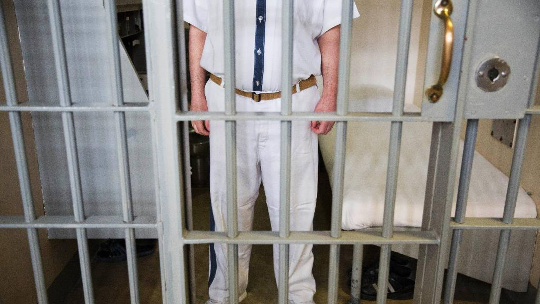 A prisoner stands at his cell at the Georgia Diagnostic and Classification Prison.