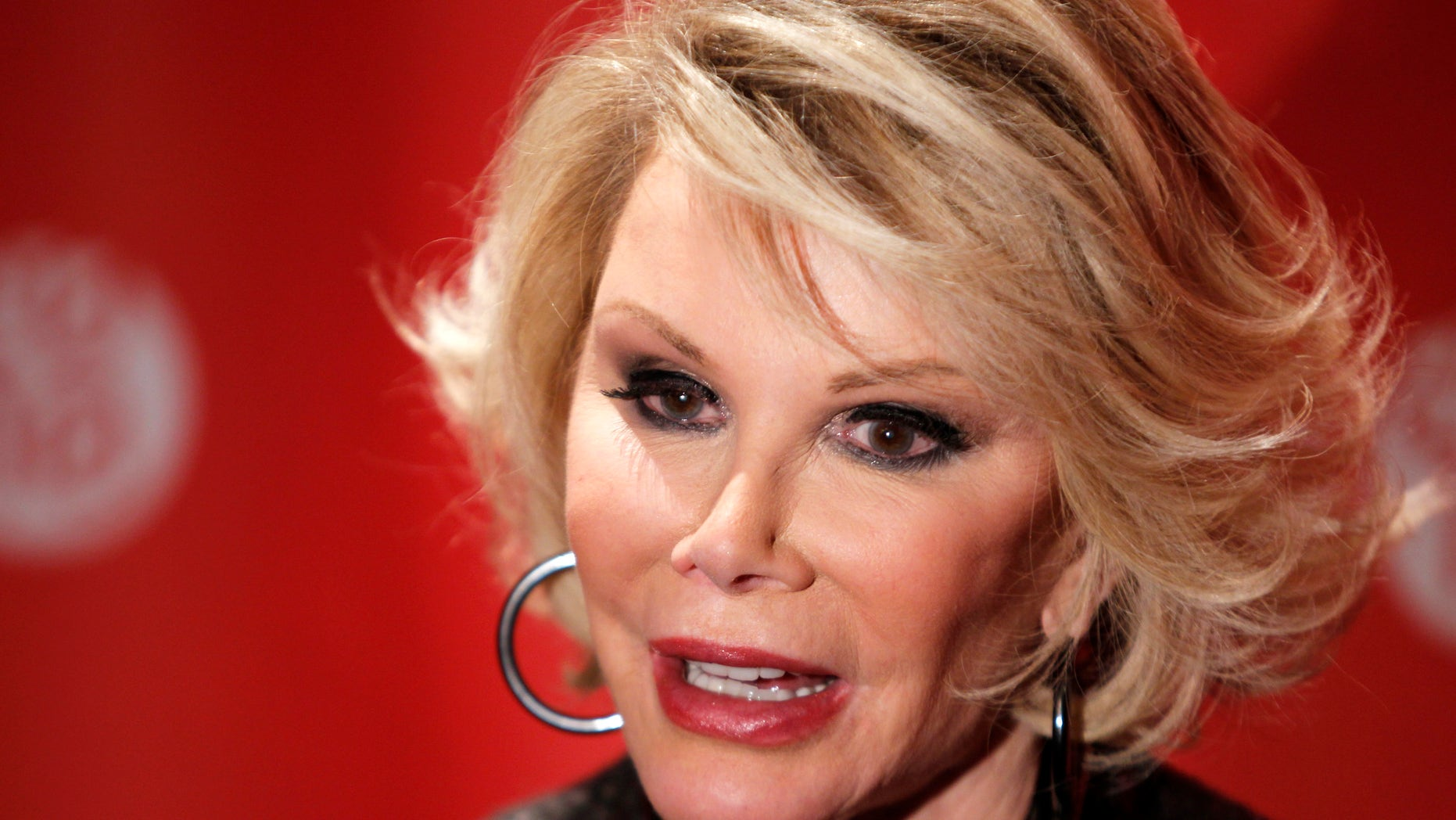 """January 25, 2010. Comedian Joan Rivers arrives for the premiere of the documentary """"Joan Rivers - A Piece Of Work"""" during the 2010 Sundance Film Festival in Park City, Utah."""