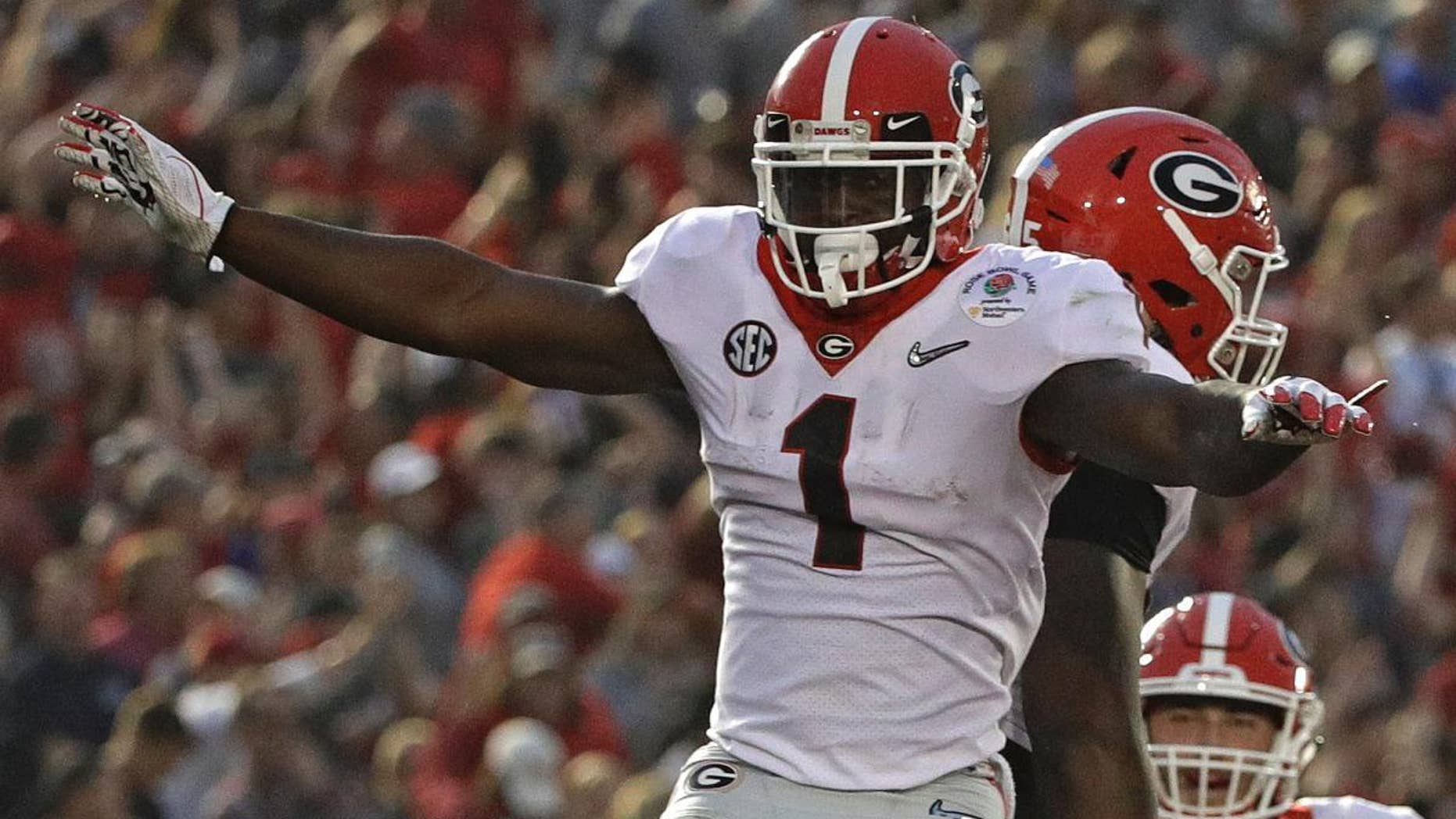 Georgia running back Sony Michel (1) celebrates after he scored a touchdown against Oklahoma during the second half of the Rose Bowl NCAA college football game Monday in Pasadena, Calif. (AP Photo/Jae C. Hong)