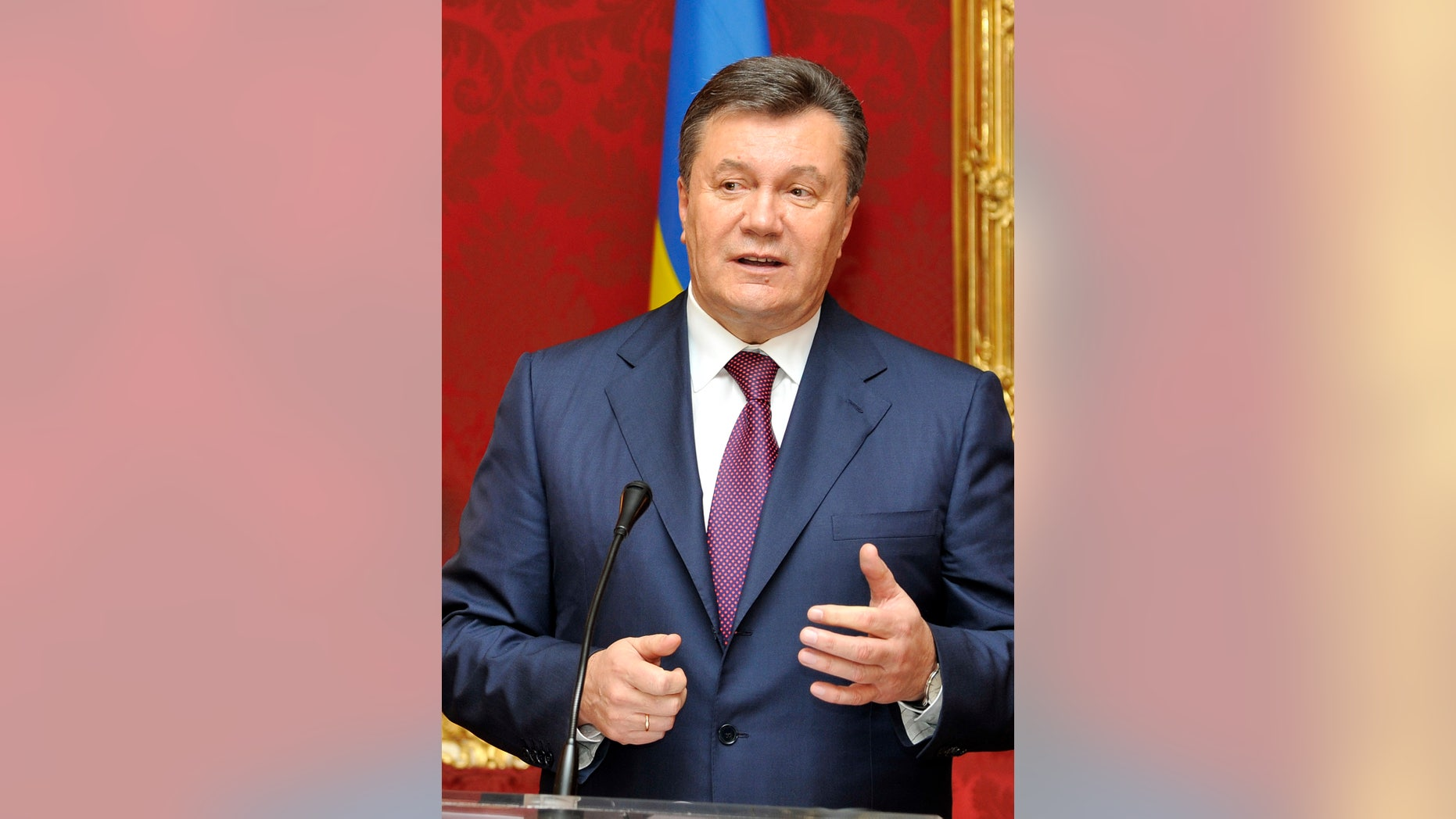 FILE - In this Thursday, Nov. 21, 2013 file photo, Ukrainian President Viktor Yanukovych speaks during a news conference after his meeting with Austrian President at the Hofburg palace, in Vienna, Austria. Yanukovych suffered a humiliation in 2004 when his victory in the fraud-tainted presidential election was declared void under the pressure of massive unprecedented protests dubbed the Orange Revolution, allowing his pro-Western rival to win power. But Yanukovych took advantage of the troubled economy and infighting in the Orange camp to win the 2010 presidential vote. (AP Photo/Hans Punz, File)
