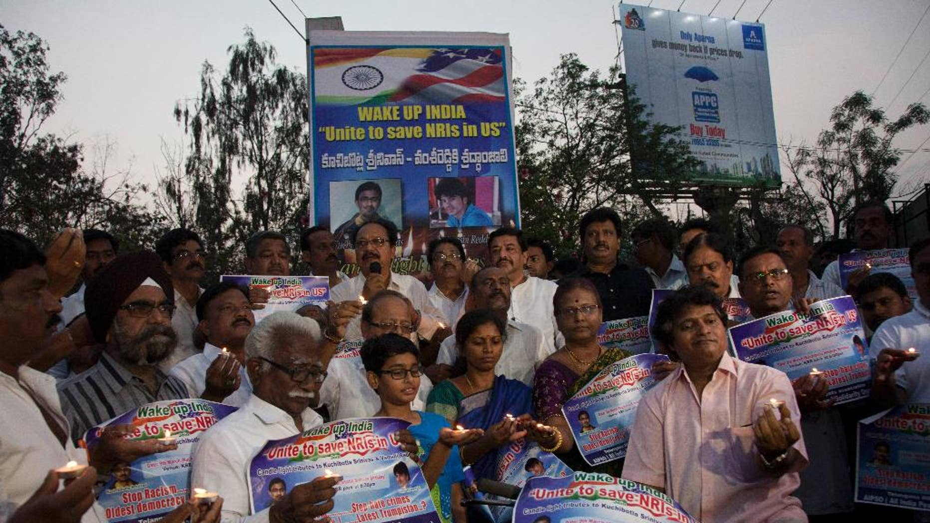 Parents of Indians living abroad are joined by others to participate in a candlelight vigil to pay their tributes to Srinivas Kuchibhotla in Hyderabad, India, Thursday, March 9, 2017. Kuchibhotla, a 32-year-old engineer who was killed in an apparently racially motivated shooting in a crowded Austin's Bar and Grill in Olathe, Kansas, a suburb of Kansas City last month. (AP Photo/Mahesh Kumar A.)
