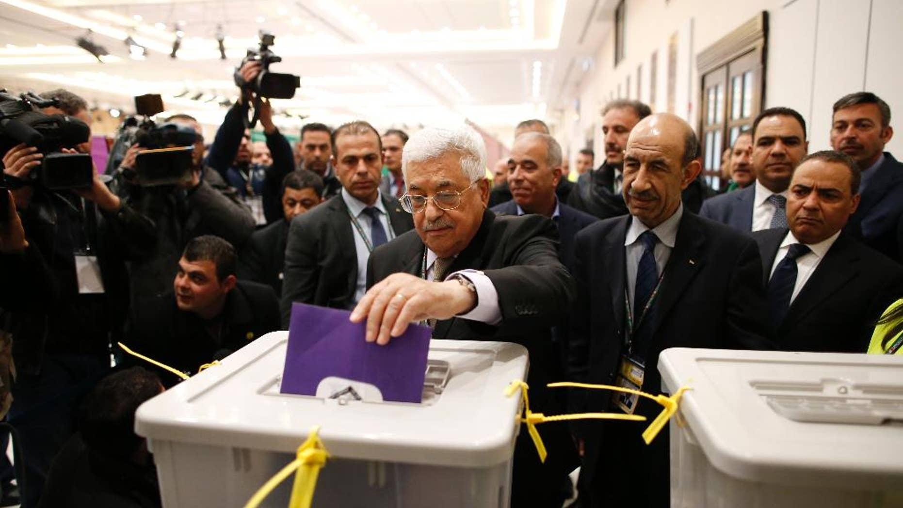 Palestinian president Mahmud Abbas casts his vote at the Muqataa, the Palestinian Authority headquarters, in the city of Ramallah, West Bank, Saturday Dec. 3, 2016. (Ahmad Gharabli/Pool photo via AP)