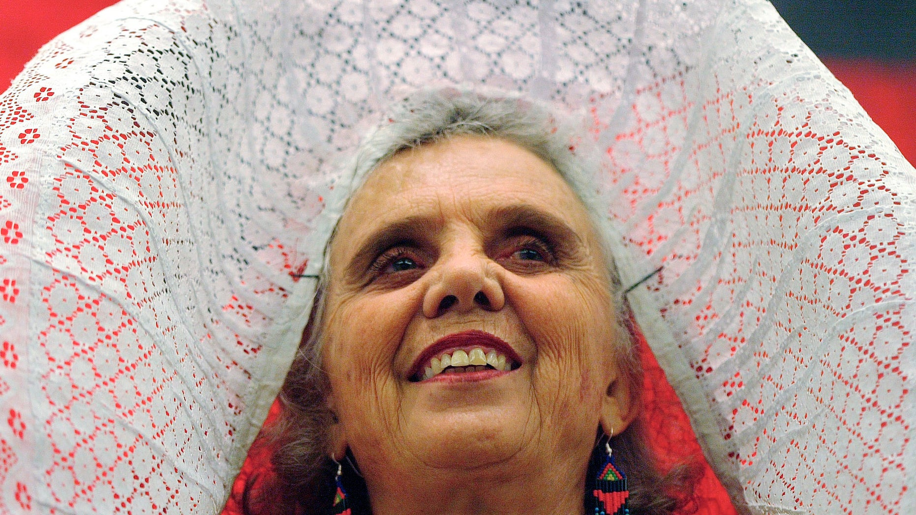 """FILE - In this Nov. 29 2005 file photo, Mexican author Elena Poniatowska, wearing a traditional tehuana outfit, smiles during the presentation of her new book """"El Tren Paso Primero"""", """"The Train Passed First"""", during the 19th Guadalajara International Book Fair in Guadalajara City, Mexico. Poniatowska has won the 2013 Cervantes Prize, the Spanish-speaking world's highest literary honor it was announced on Tuesday Nov. 19, 2013. The euro 125,000 prize generally alternates between Spanish and Latin American writers. Previous winners include Carlos Fuentes of Mexico, and Nobel prize winners Mario Vargas Llosa of Peru and Spain's late Camilo Jose Cela. They are presented each April 23, the anniversary of the death of Miguel de Cervantes, author of """"Don Quijote."""" (AP Photo/Guillermo Arias, File)"""