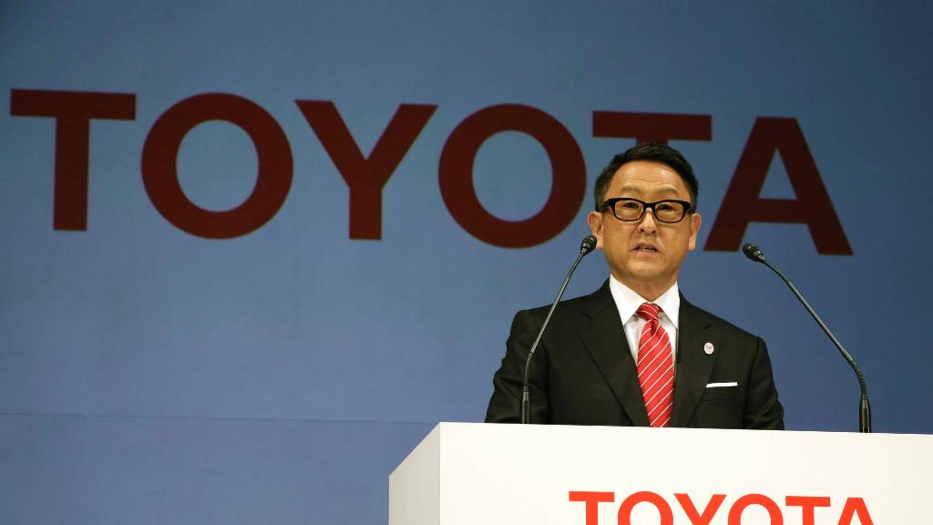 """FILE- In this March 13, 2015, file photo, Toyota President and CEO Akio Toyoda speaks during a press conference in Tokyo. Toyota Motor Corp. stock is skidding in Tokyo trading after U.S. President-elect Donald Trump said Thursday, Jan. 5, 2017 on Twitter that the Japanese automaker faces a """"big border tax"""" if it goes ahead with plans on a new Mexico plant. (AP Photo/Eugene Hoshiko, File)"""