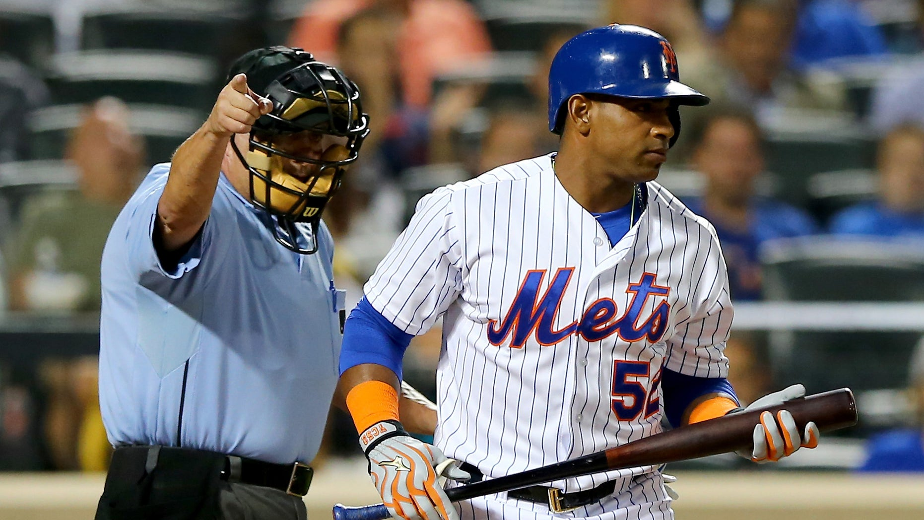 NEW YORK, NY - SEPTEMBER 15:  Home plate umpire Dale Scott sends Yoenis Cespedes #52 of the New York Mets to first after he is hit by a pitch from Tom Koehler #34 of the Miami Marlins in the first inning on September 15, 2015 at Citi Field in the Flushing neighborhood of the Queens borough of New York City.  (Photo by Elsa/Getty Images)
