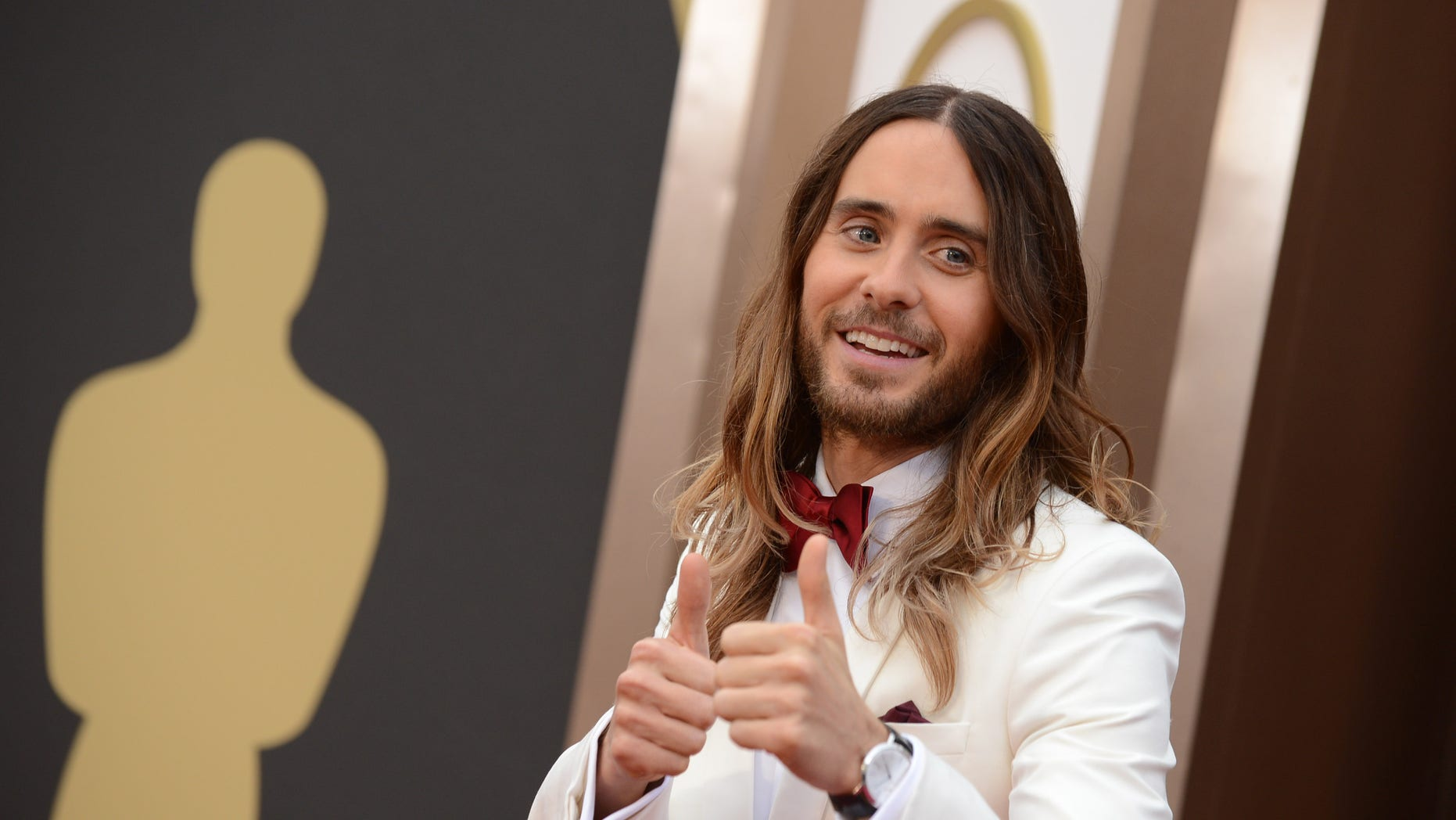 Jared Leto arrives at the Oscars on Sunday, March 2, 2014, at the Dolby Theatre in Los Angeles.  (Photo by Jordan Strauss/Invision/AP)