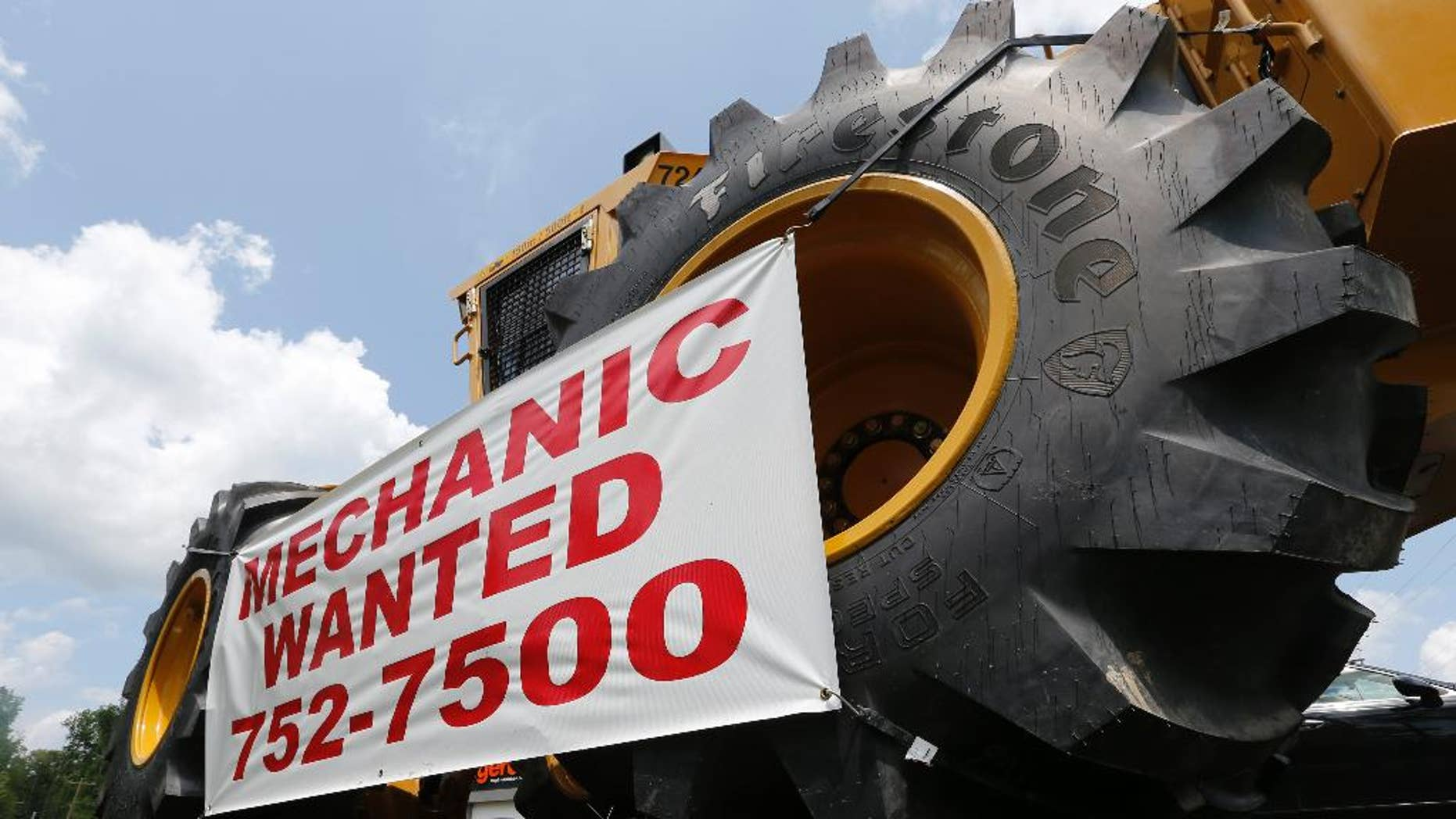 A help wanted sign is posted at a tractor dealership in Ashland, Va., Tuesday, June 9, 2015. The U.S. Labor Department reports on the number of people who applied for unemployment benefits during the week ending June 6 on Thursday, June 11, 2015.  (AP Photo/Steve Helber)