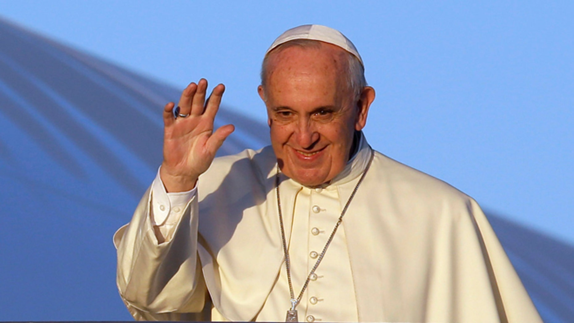 Pope Francis waves to journalists as he boards his airplane to Africa on Nov. 25, 2015.