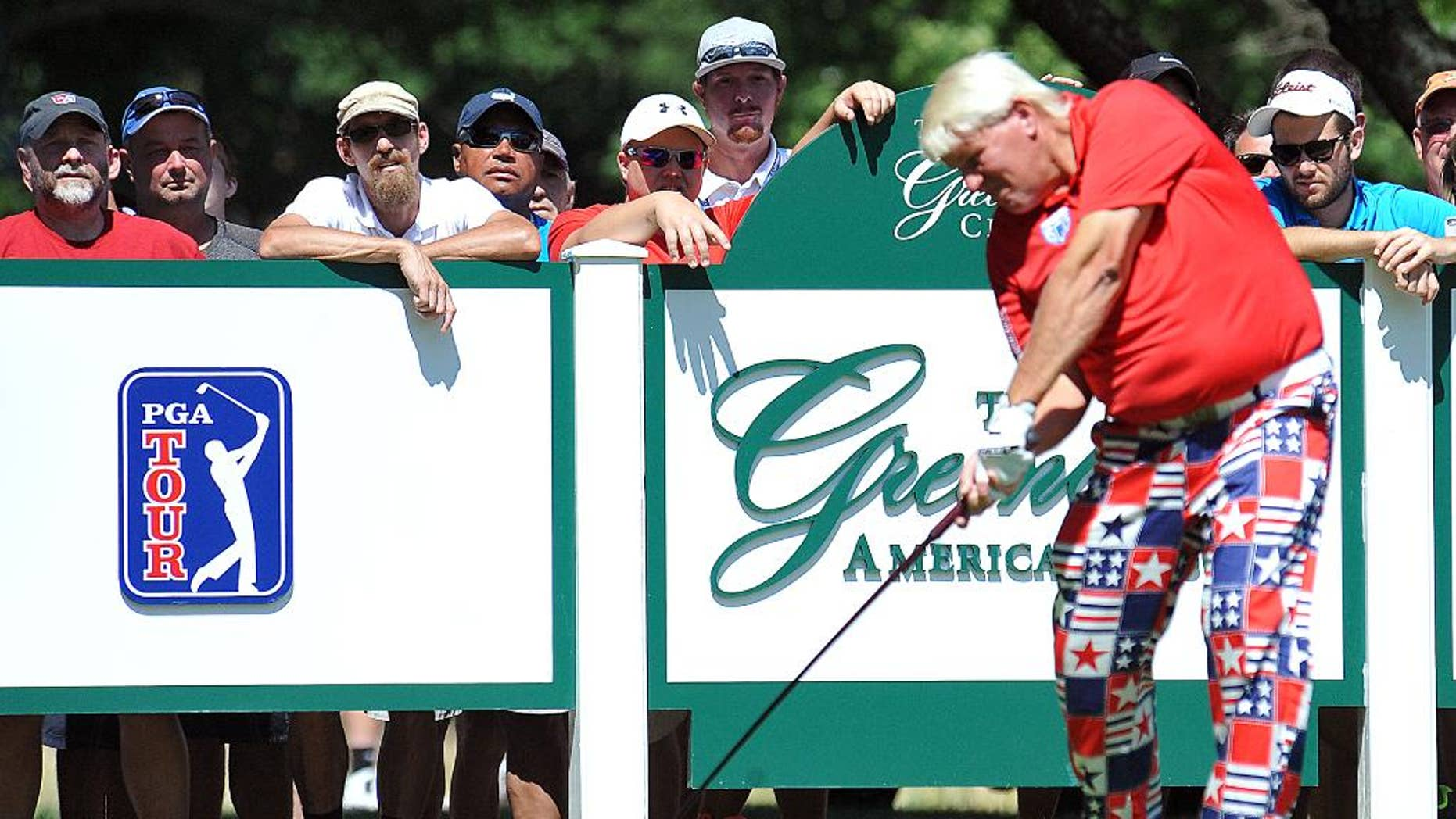 John Daly tees off on the eighth hole during the second round of the Greenbrier Classic golf tournament at the Greenbrier Resort in White Sulphur Springs, W.Va., Friday, July 4, 2014. (AP Photo/Chris Tilley)