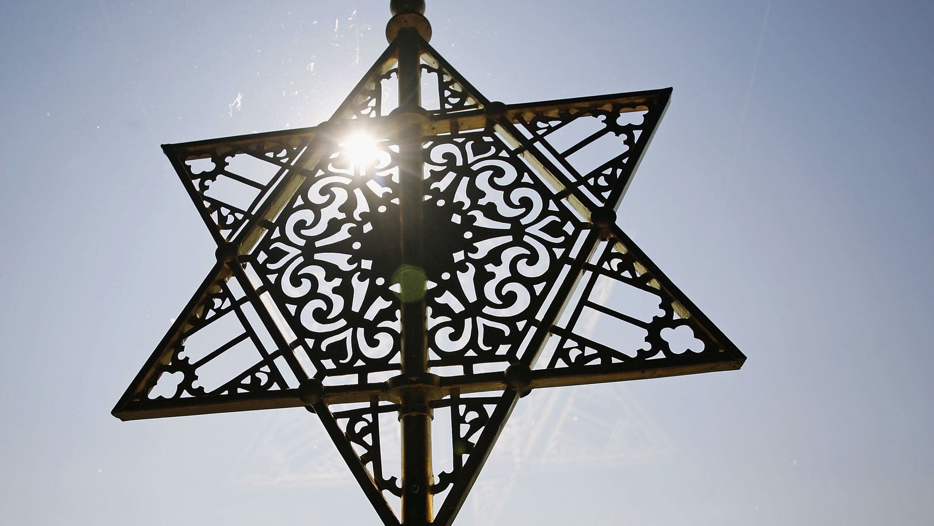 """DRESDEN, GERMANY - SEPTEMBER 14: The Star of David is seen over the entrance of the New Synagoge at the ordination of new rabbis on September 14, 2006 in Dresden, Germany. Abraham Geiger College, the first liberal rabbinical seminary founded in Continental Europe since World War II, ordains the first three candidates as rabbis since the """"Hochschule fuer die Wissenschaft des Judentums"""" in Berlin was forcefully closed in 1942. The three newly ordained rabbis will become members of the Central Conference of American Rabbis and will serve communities in Munich, Oldenburg and Cape Town. (Photo by Carsten Koall/Getty Images)"""