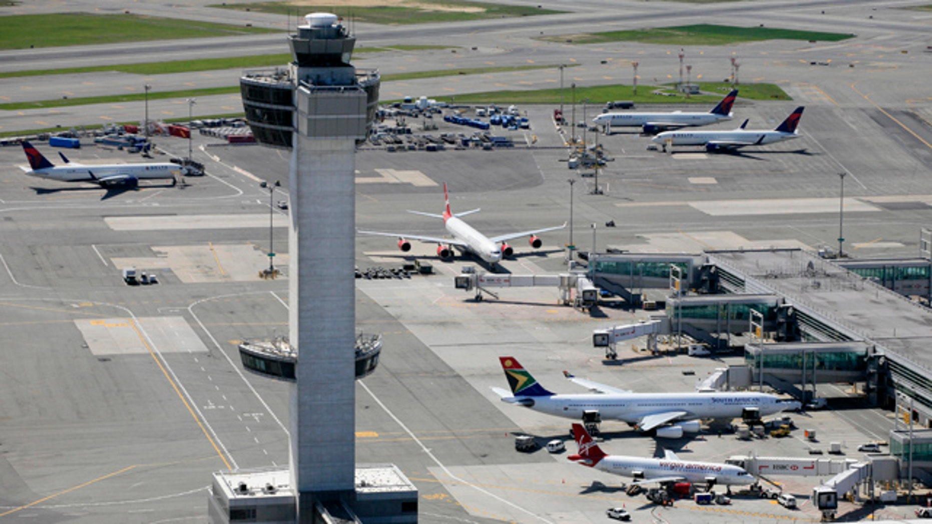 FILE: April 2010:  The air traffic control tower and terminals at John F. Kennedy International Airport in New York.