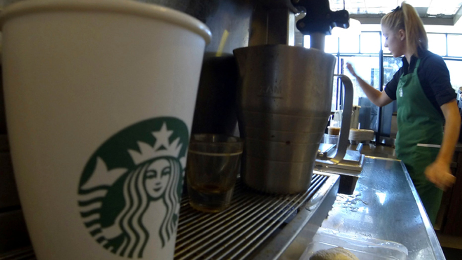"""Starbucks says it will expand alcohol sales to """"thousands of select stores"""" over the next several years, although it didn't provide an exact timeline. (Reuters)"""