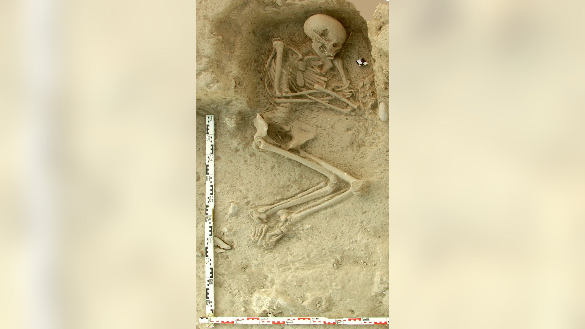 This undated picture provided by the Paliambela Excavation Project Archive, shows a human burial from the archaeological site of Paliambela in northern Greece. Stone Age people from the Aegean region moved into central and southern Europe some 8,000 years ago and introduced agriculture to a continent still dominated at the time by hunter-gatherers, scientists say. The findings were published Monday June 6, 2016  in the Proceedings of the National Academy of Science. (K. Kotsakis, P. Halstead/Paliambela Excavation Project Archive via AP)