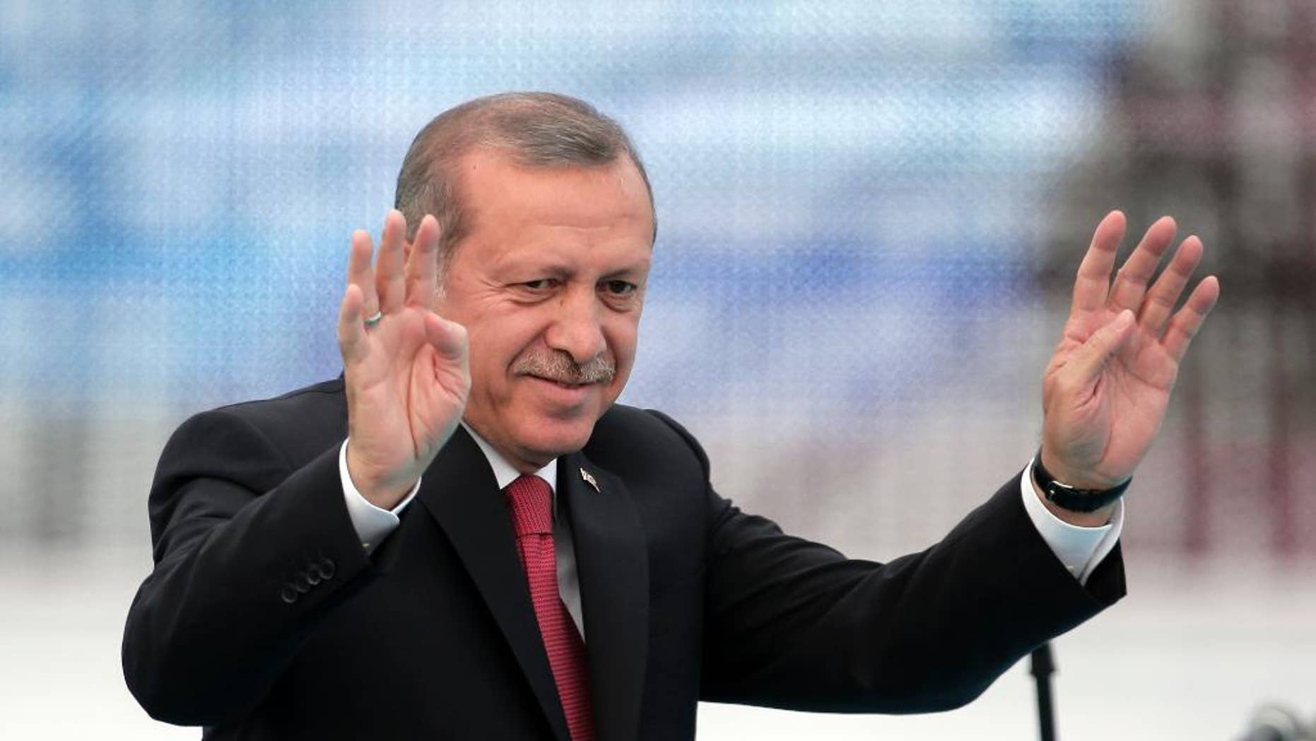 Turkey's President Recep Tayyip Erdogan waves to people gathered during a rally to commemorate the anniversary of the city's conquest by the Ottoman Turks, Istanbul, Turkey, Saturday, May 30, 2015. The Justice and Development Party (AKP), which has been ruling Turkey since 2002, is running in the upcoming general elections which are to be held on June 7, 2015, where approximately 56 million Turkish voters are eligible to cast their ballots to elect the 550 members of the Grand National Assembly. (AP Photo/Lefteris Pitarakis)
