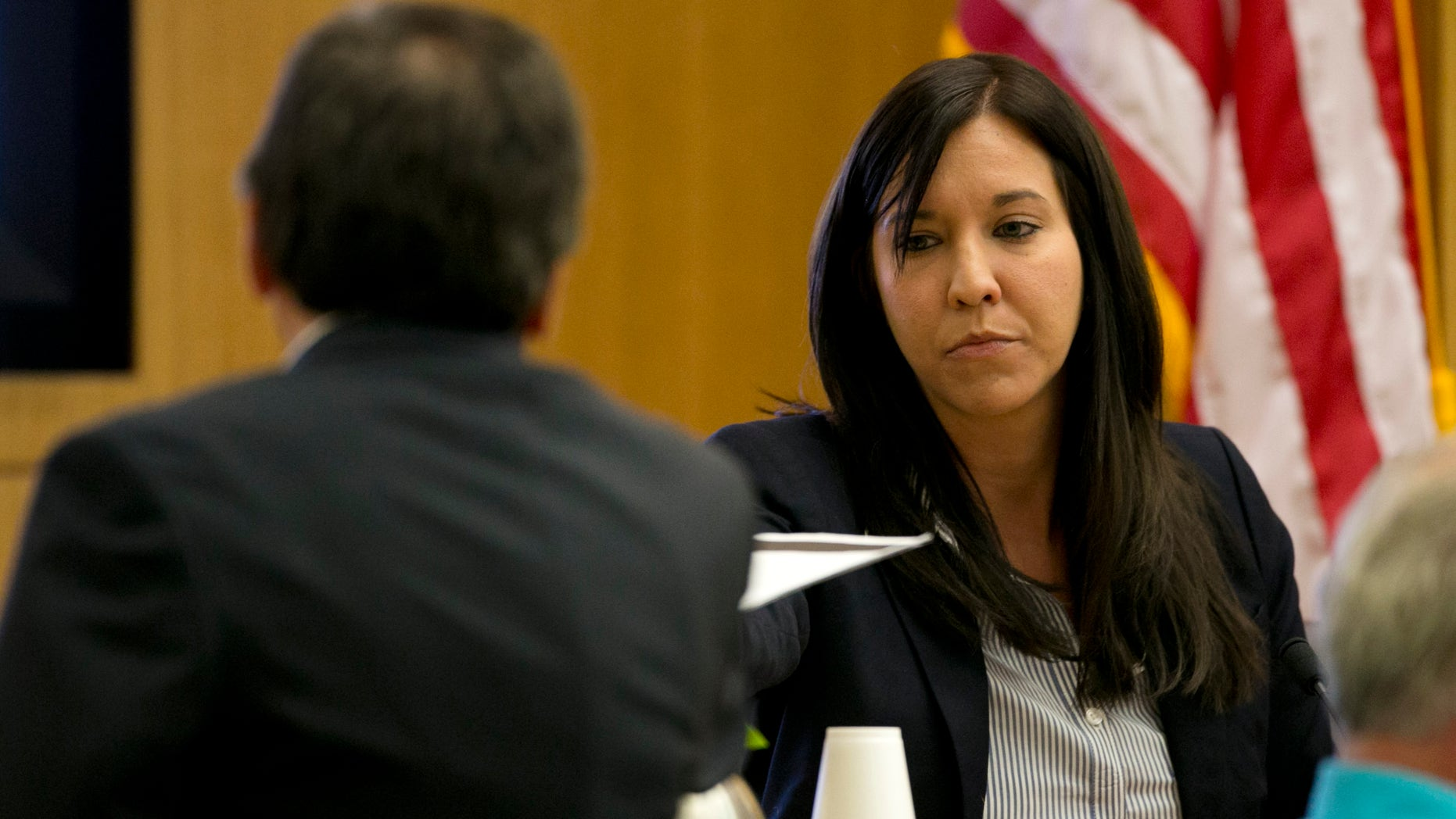 Dr. Janeen DeMarte an expert witness for the prosecution takes evidence from Prosecutor Juan Martinez during the Jodi Arias trial at Maricopa County Superior Court in Phoenix on Tuesday, April 16, 2013. Defense attorneys rested their case Tuesday after about 2 1/2 months of testimony aimed at portraying Arias as a domestic violence victim who fought for her life the day she killed her one-time boyfriend. (AP Photo/The Arizona Republic, David Wallace, Pool)