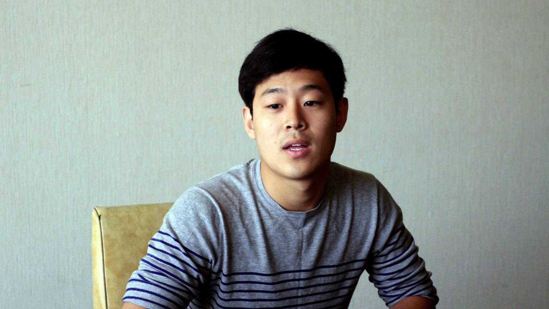 FILE - In this Tuesday, July 14, 2015, file photo, Joo Won-moon, a South Korean student at New York University, is interviewed at the Koryo Hotel in Pyongyang, North Korea.  Joo,  South Korean citizen and resident of the U.S. who has been detained in North Korea for five months,  was presented to the media in Pyongyang on Friday, Sept. 25,  and said he has not been able to contact his family but wanted them to know he is healthy. (AP Photo/Kim Kwang Hyon, File)