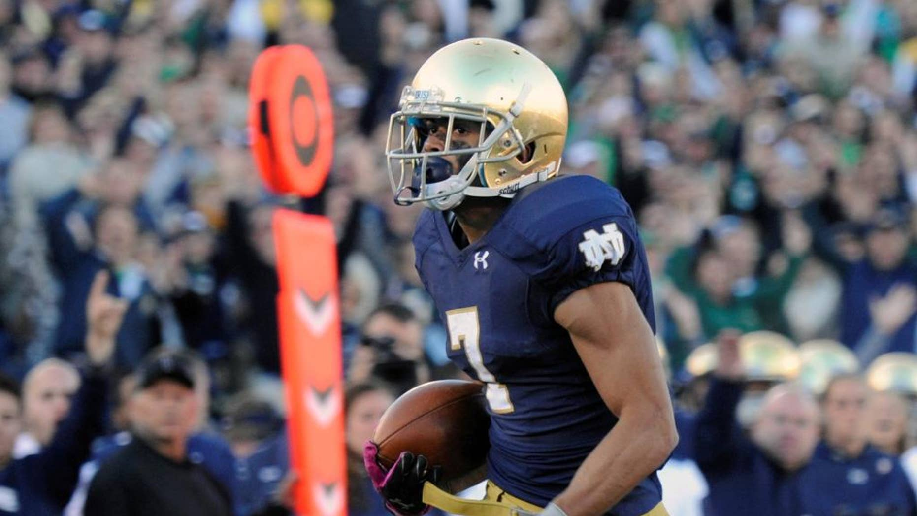 Notre Dame wide receiver Will Fuller heads towards the endzone for a touchdown in the second half of an NCAA college football game against North Carolina, Saturday, Oct. 11, 2014, in South Bend, Ind. (AP Photo/Joe Raymond)
