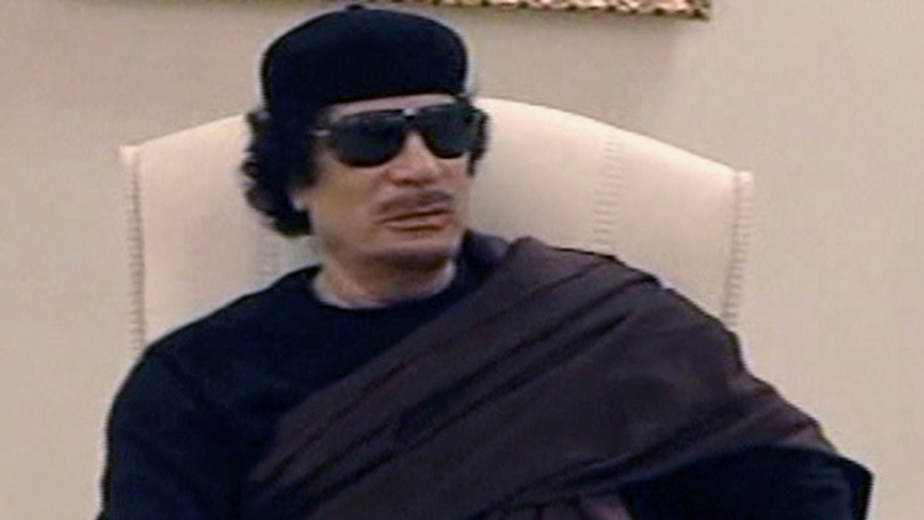 May 11: In this image made from Libyan TV, Libyan leader Muammar al-Qaddafi holds a meeting with tribal leaders from eastern Libya.