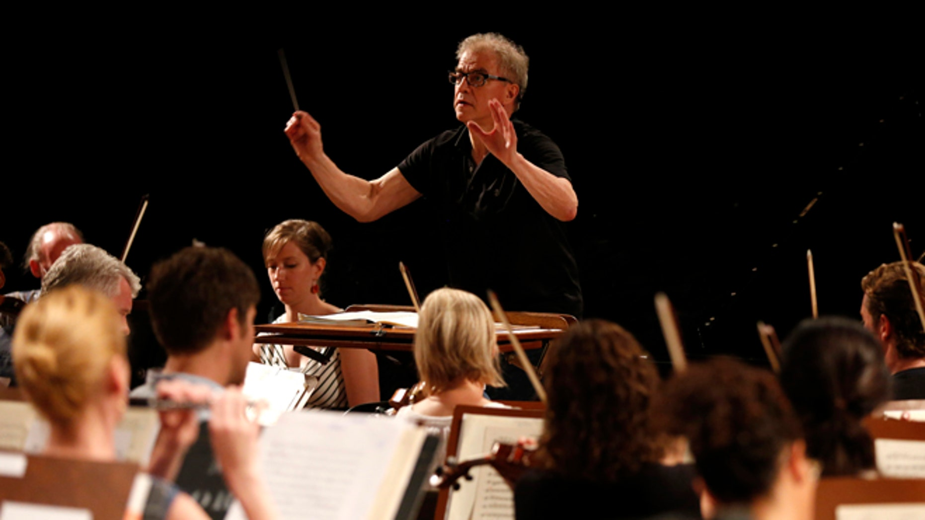 Minnesota Orchestra Music Director Osmo Vanska of Finland conducts a rehearsal in Havana, Cuba, Thursday, May 14, 2015. The Minnesota Orchestra also played Havana in 1929 and 1930, when it was called the Minneapolis Symphony. Fridays all-Beethoven program was a reprise of its 1929 repertoire, with performances of Overture to Egmont, Opus 84, Fantasy in C minor for piano, chorus and orchestra, Opus 80, and Symphony No. 3 in E-flat major, Opus 55.  (AP Photo/Desmond Boylan)