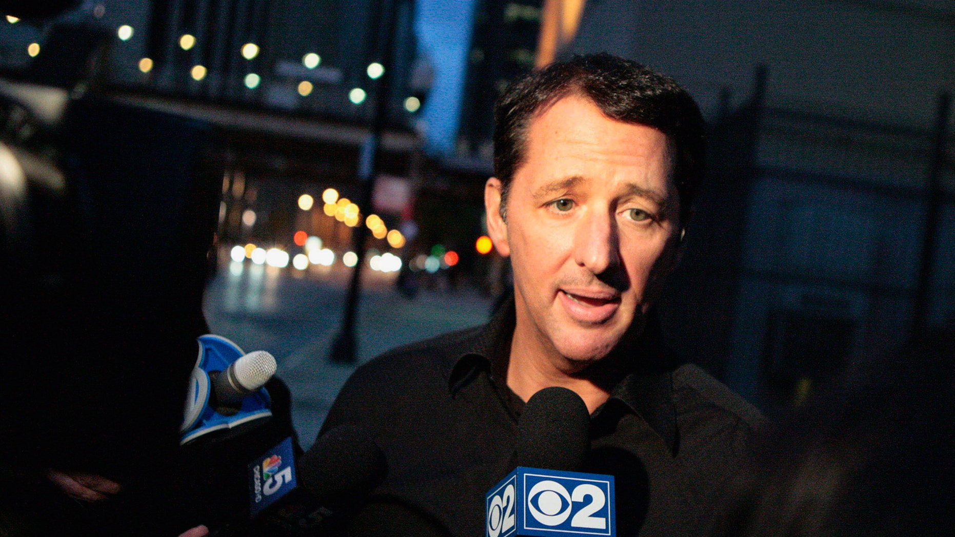 In this photo taken on Oct. 28, 2013, television infomercial pitchman Kevin Trudeau speaks to the media after leaving the Metropolitan Correctional Center in downtown Chicago. On Tuesday, Nov. 12, 2013, Trudeau's attorney and government attorneys began delivering closing arguments in his criminal contempt trial, after federal prosecutors spent nearly a week trying to prove the TV pitchman made false claims about his best-selling diet book. (AP Photo/Sun-Times Media, Michael Jarecki) MANDATORY CREDIT, MAGS OUT