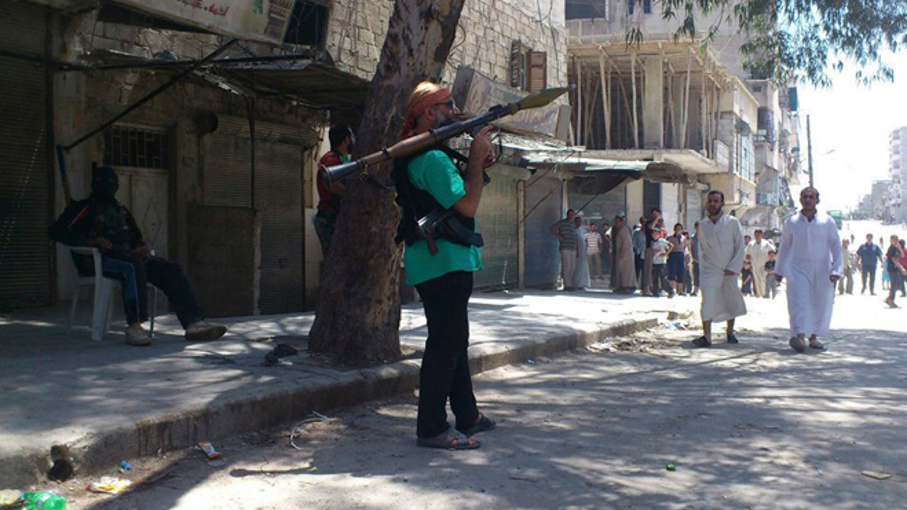 July 20: Members of the Free Syrian Army patrol in Sukari, Aleppo province.