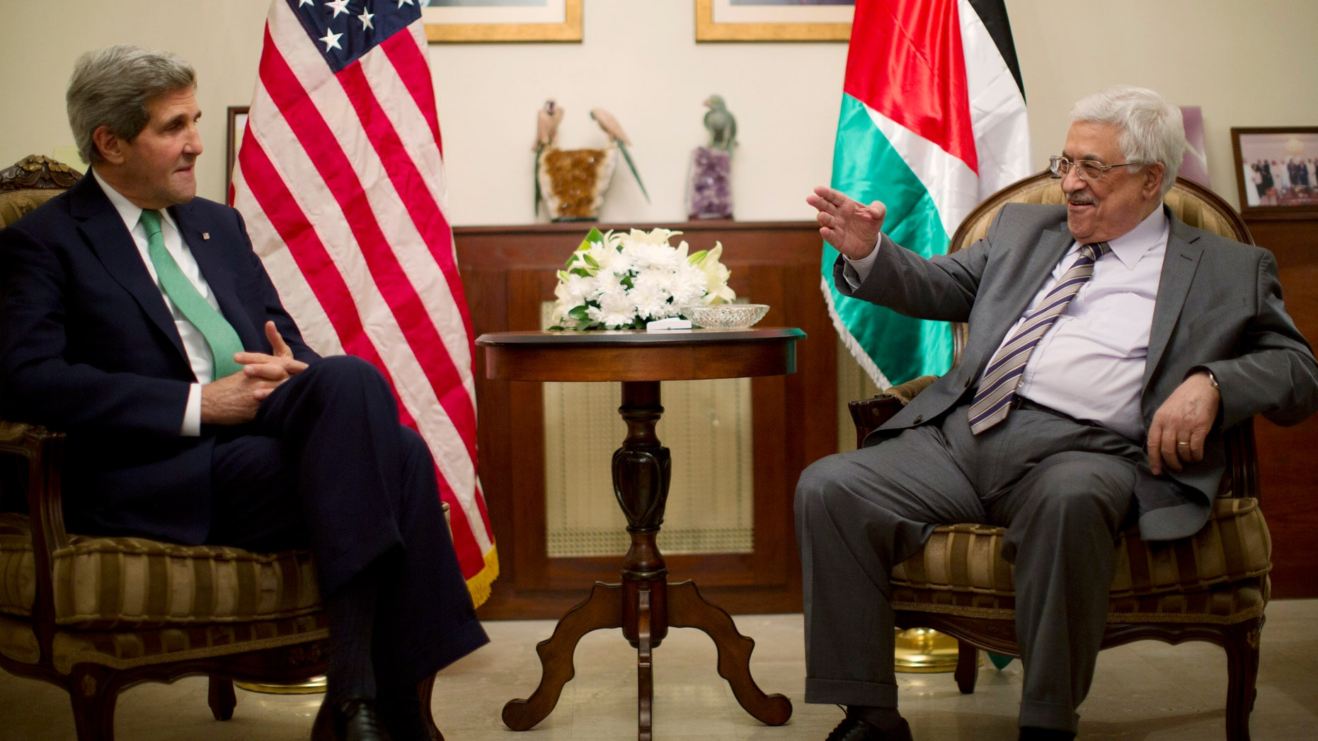 U.S. Secretary of State John Kerry, left, meets with Palestinian President President Mahmoud Abbas in Amman, Jordan, Thursday, Nov. 7, 2013. (AP Photo/Jason Reed, Pool)