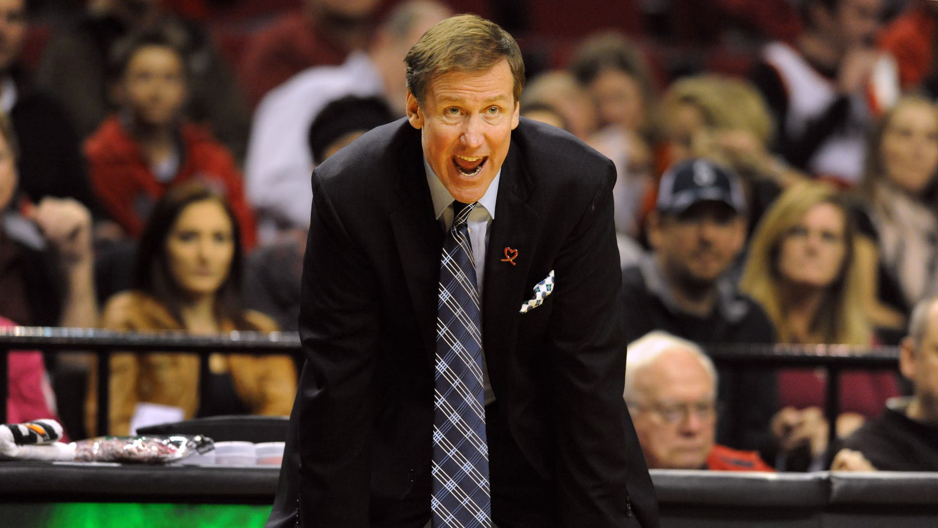 Portland Trail Blazers head coach Terry Stotts yells out to his team during the second half of an NBA basketball game against the Sacramento Kings on Sunday, October 20, 2013, in Portland. Portland won 109-105. (AP Photo/Steve Dykes)