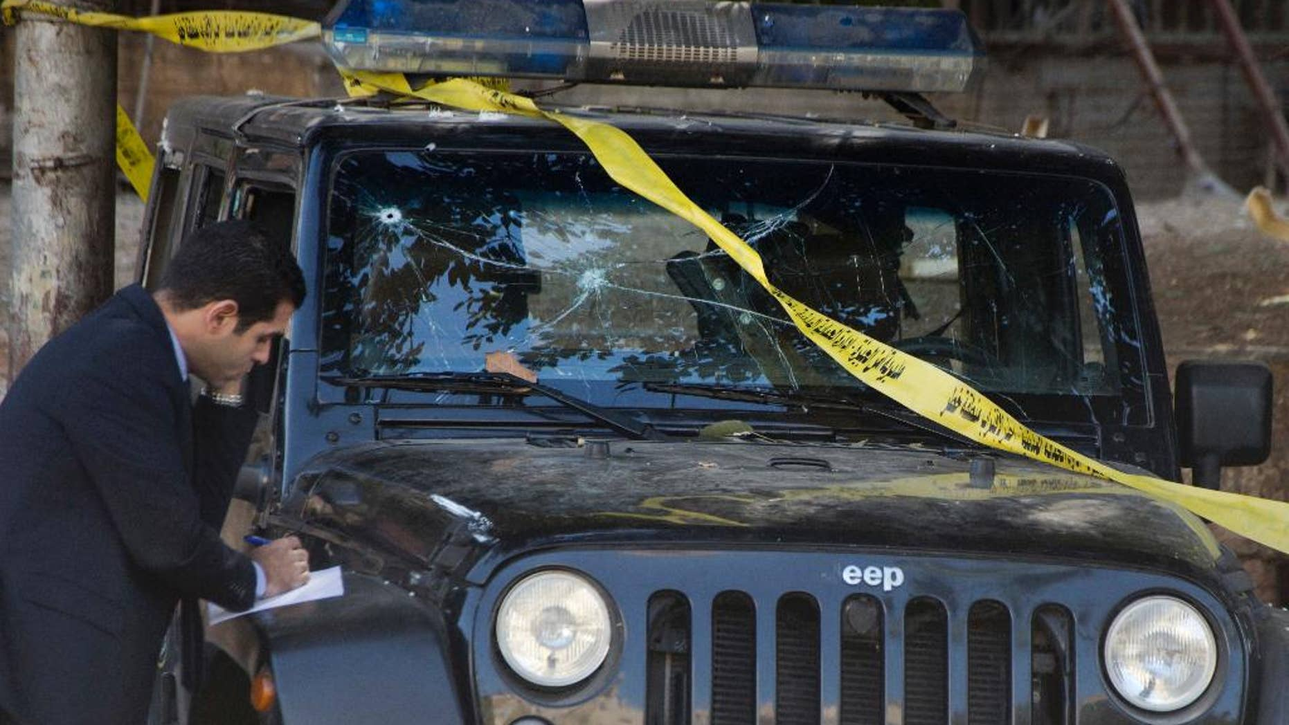 A damaged police vehicle after the explosion.