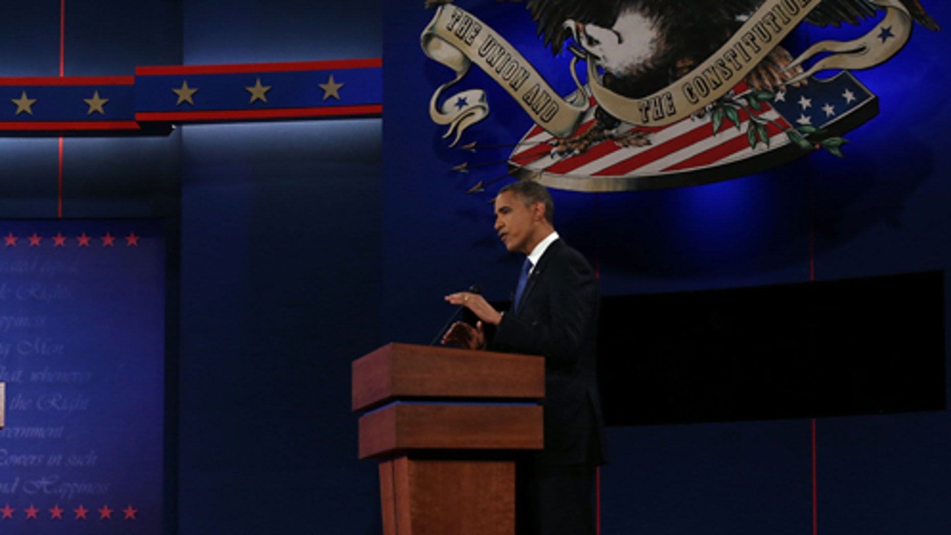 DENVER, CO - OCTOBER 03:  Democratic presidential candidate, U.S. President Barack Obama (R) speaks as Republican presidential candidate, former Massachusetts Gov. Mitt Romney listens during the Presidential Debate at the University of Denver on October 3, 2012 in Denver, Colorado. The first of four debates for the 2012 Election, three Presidential and one Vice Presidential, is moderated by PBS's Jim Lehrer and focuses on domestic issues:  the economy, health care, and the role of government.  (Photo by Justin Sullivan/Getty Images)