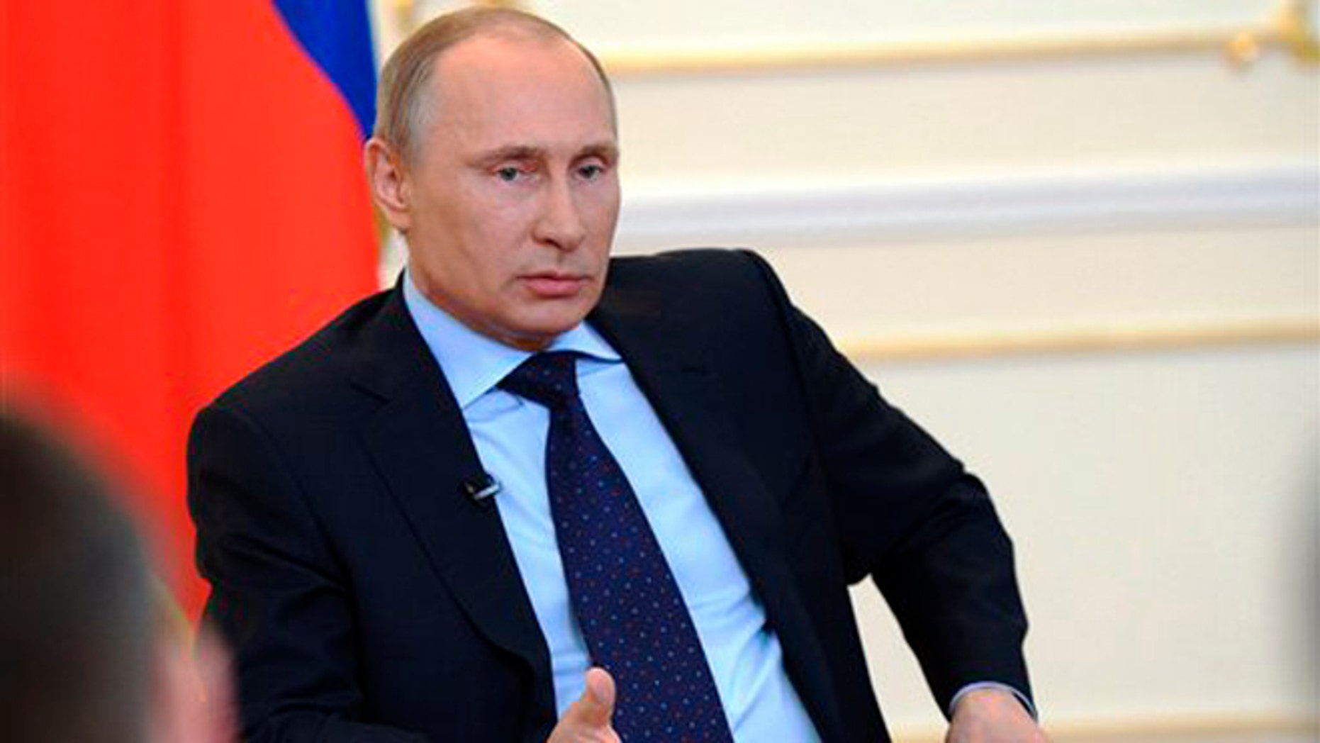 March 4, 2014: President Vladimir Putin answers journalists' questions on current situation in Ukraine at the Novo-Ogaryovo presidential residence outside Moscow.