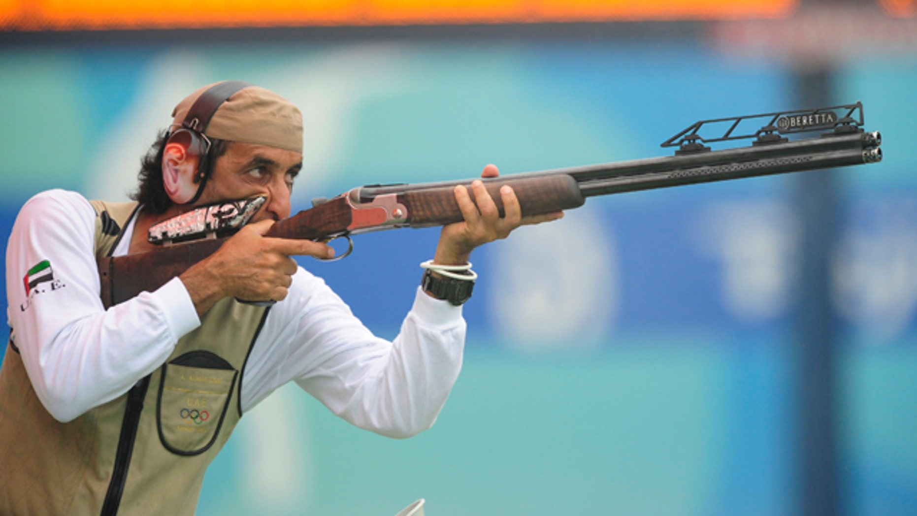 Ahmed Almaktoum of UAE shoots during the qualifying round of the men's trap competition at the Beijing 2008 Olympic Games August 10, 2008.