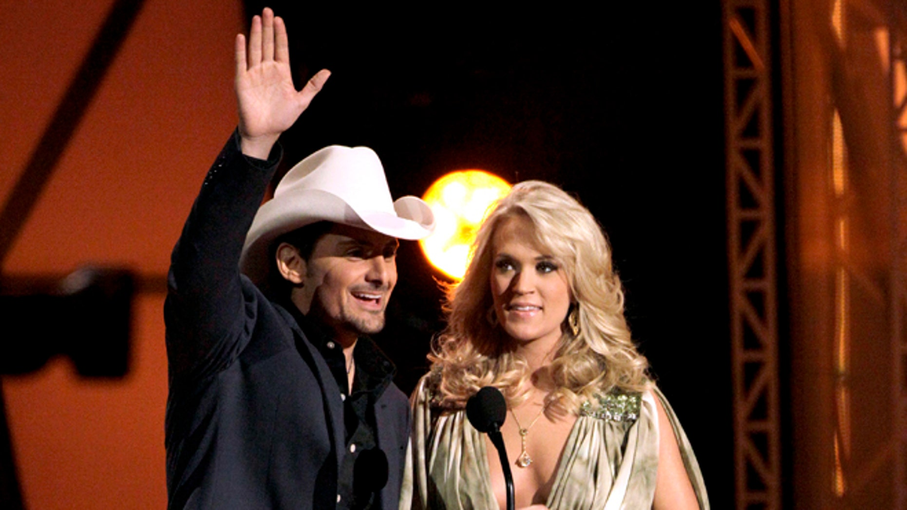 Nov. 9, 2011: This file photo shows hosts Brad Paisley, left, and Carrie Underwood speak during the 45th Annual CMA Awards in Nashville, Tenn.