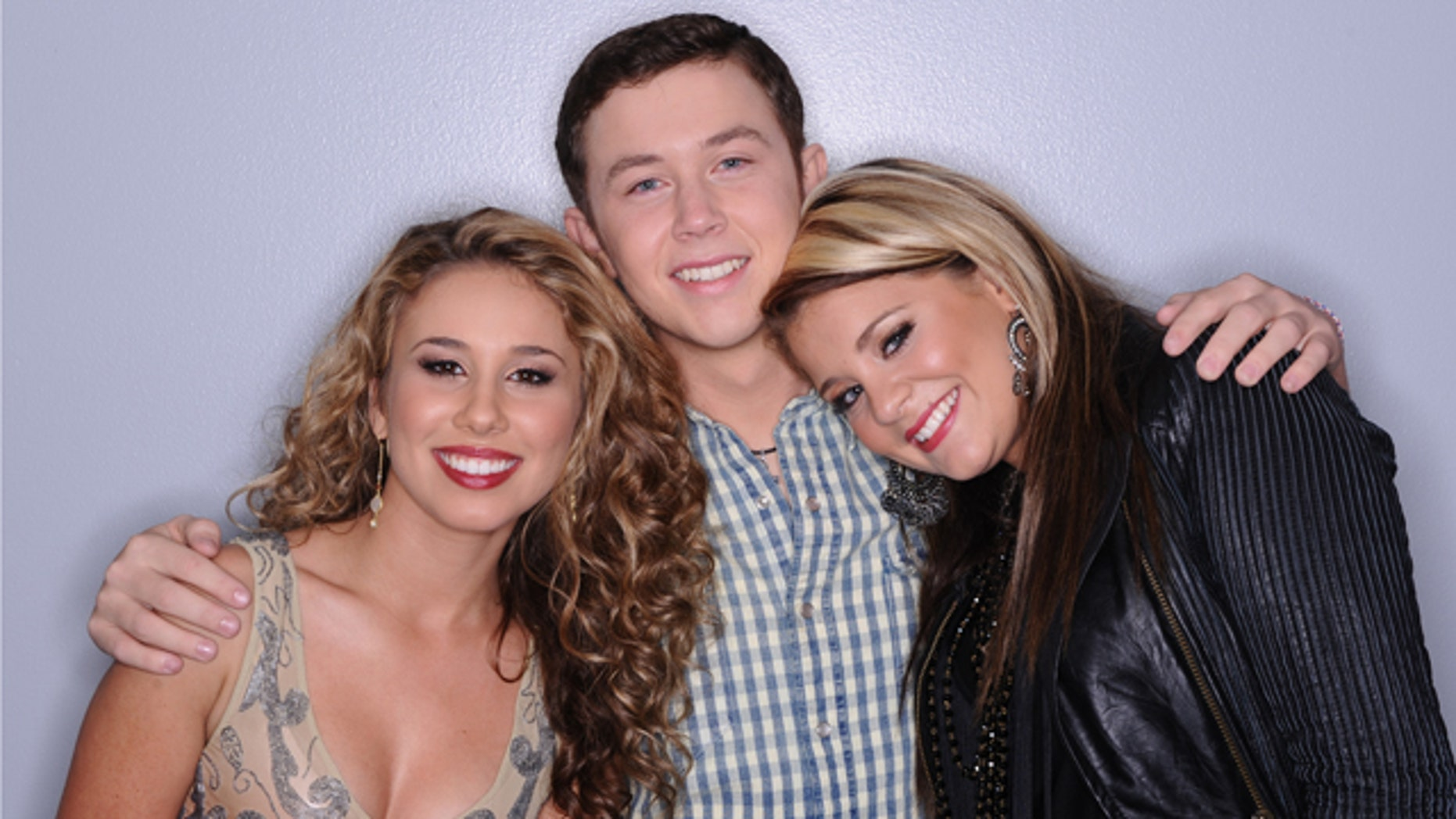 "May 12: In this publicity image released by Fox, the final three contestants on the singing competition series, ""American Idol"" from left,  Haley Reinhart, Scotty McCreery and Lauren Alaina, are shown in Los Angeles."