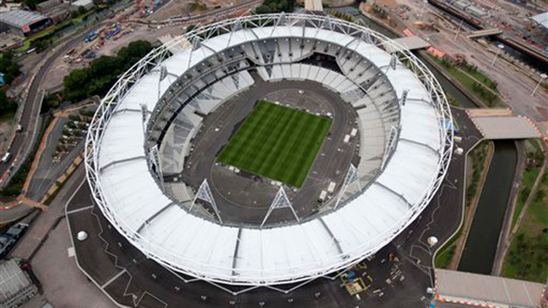 In this photo taken July 14, 2011 and made available by the Olympic Delivery Authority, an aerial view of the Olympic stadium is seen at the Olympic Park, London. With exactly a year to go until the start of the London 2012 Games, the Olympic Delivery Authority, ODA, has announced that the Aquatics Center is now complete, the last of the six main permanent Olympic Park venues to finish construction. (AP Photo/Olympic Delivery Authority, Anthony Charlton)  EDITORIAL USE ONLY