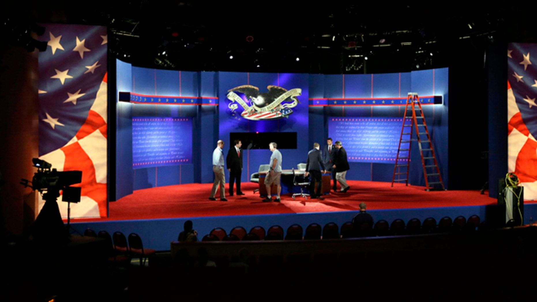 Oct. 21, 2012: Technicians work on the stage during final preparations for Monday's presidential debate between President Barack Obama and Republican presidential candidate, former Massachusetts Gov. Mitt Romney at Lynn University in Boca Raton, Fla.