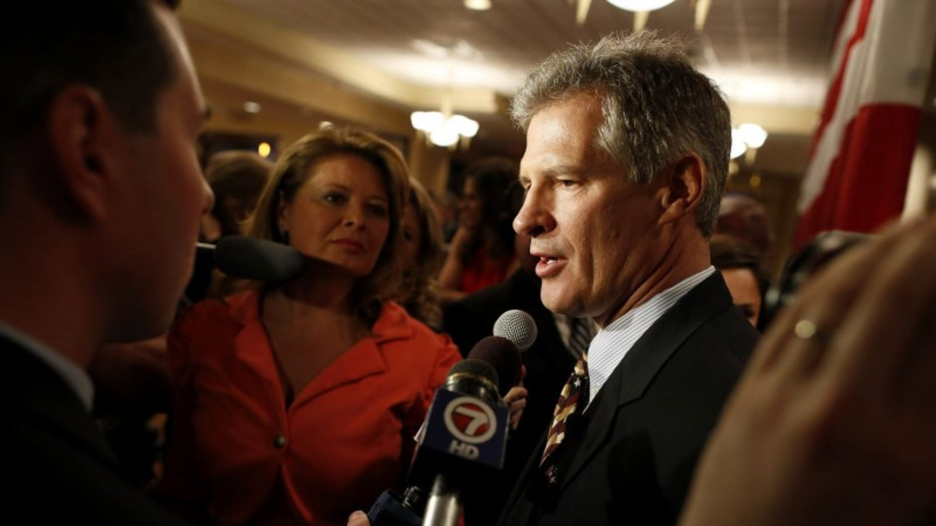 Republican Scott Brown talks to the media after announcing his bid for the United States Senate primary election in Portsmouth, N.H., April 10, 2014. (REUTERS/Dominick Reuter)