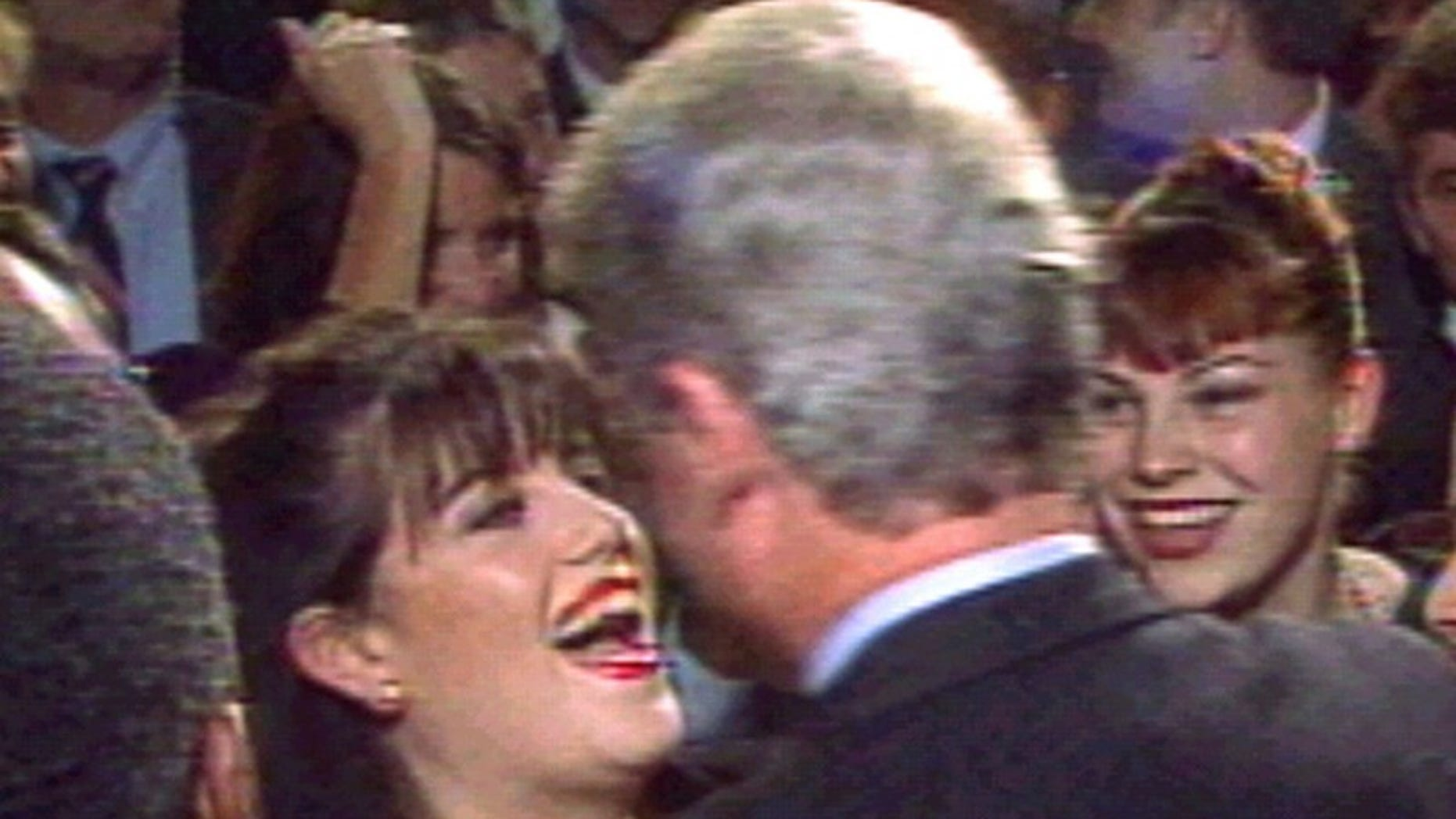 President Clinton greets Monica Lewinsky (L) at a Washington fundraising event in October 1996. (REUTERS/File)