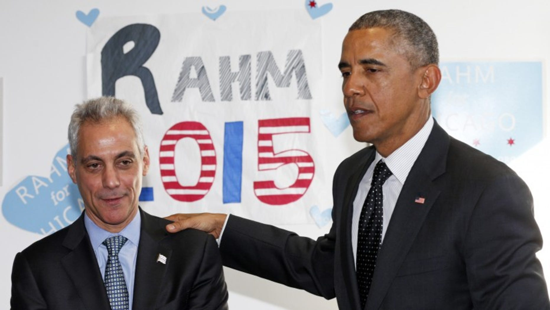 U.S. President Barack Obama puts his hand on Chicago Mayor Rahm Emanuel's shoulder as they visit a campaign office in Chicago February 19, 2015. REUTERS/Kevin Lamarque