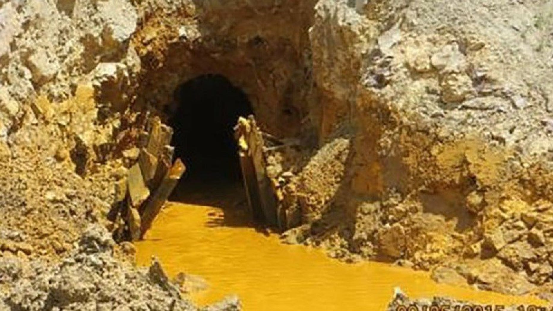Yellow mine waste water is seen at the entrance to the Gold King Mine in San Juan County, Colorado, in this picture released by the Environmental Protection Agency (EPA) taken August 5, 2015.  REUTERS/EPA/Handout