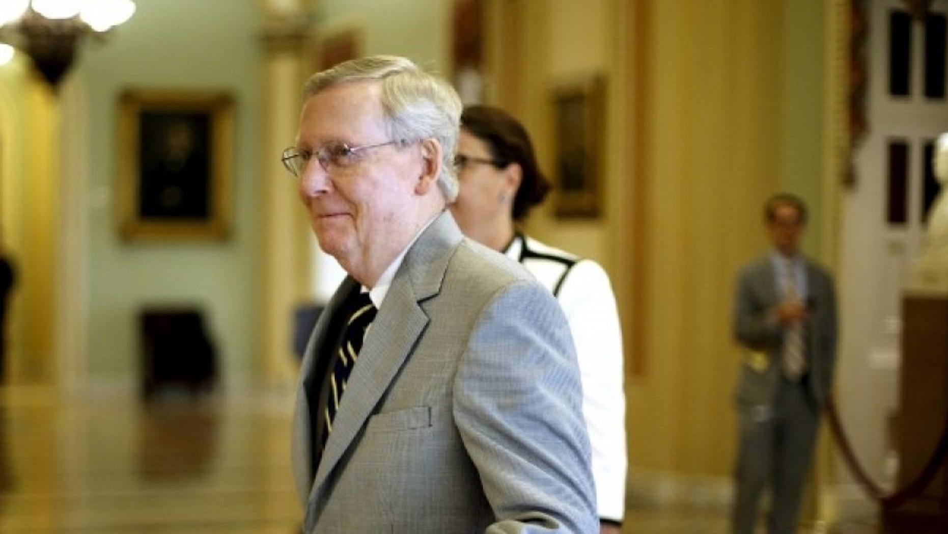 U.S. Senate Majority Leader Mitch McConnell (R-KY) gives a wave to staff members as he walks to the senate floor at the U.S. Capitol in Washington September 8, 2015.  REUTERS/Jonathan Ernst