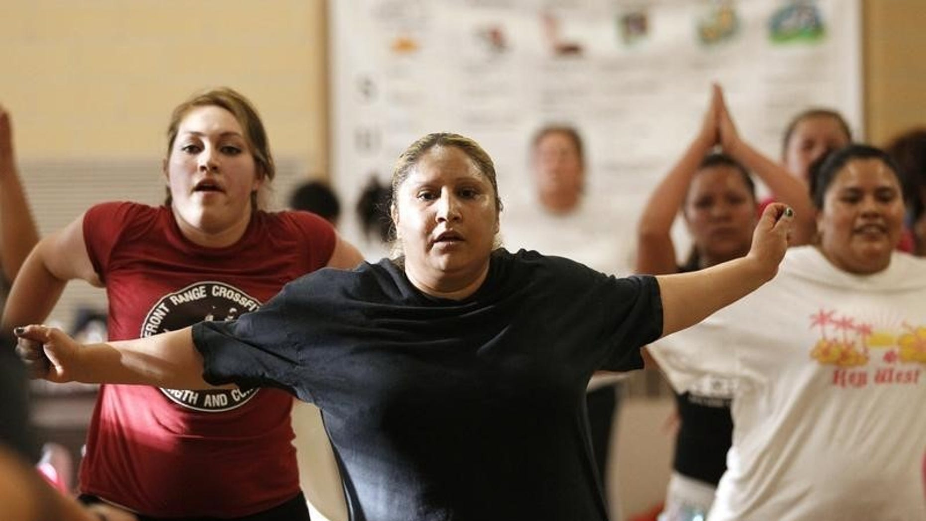 Women participate in a Zumba exercise class in a low-income neighborhood of Denver May 15, 2012. REUTERS/Rick Wilking